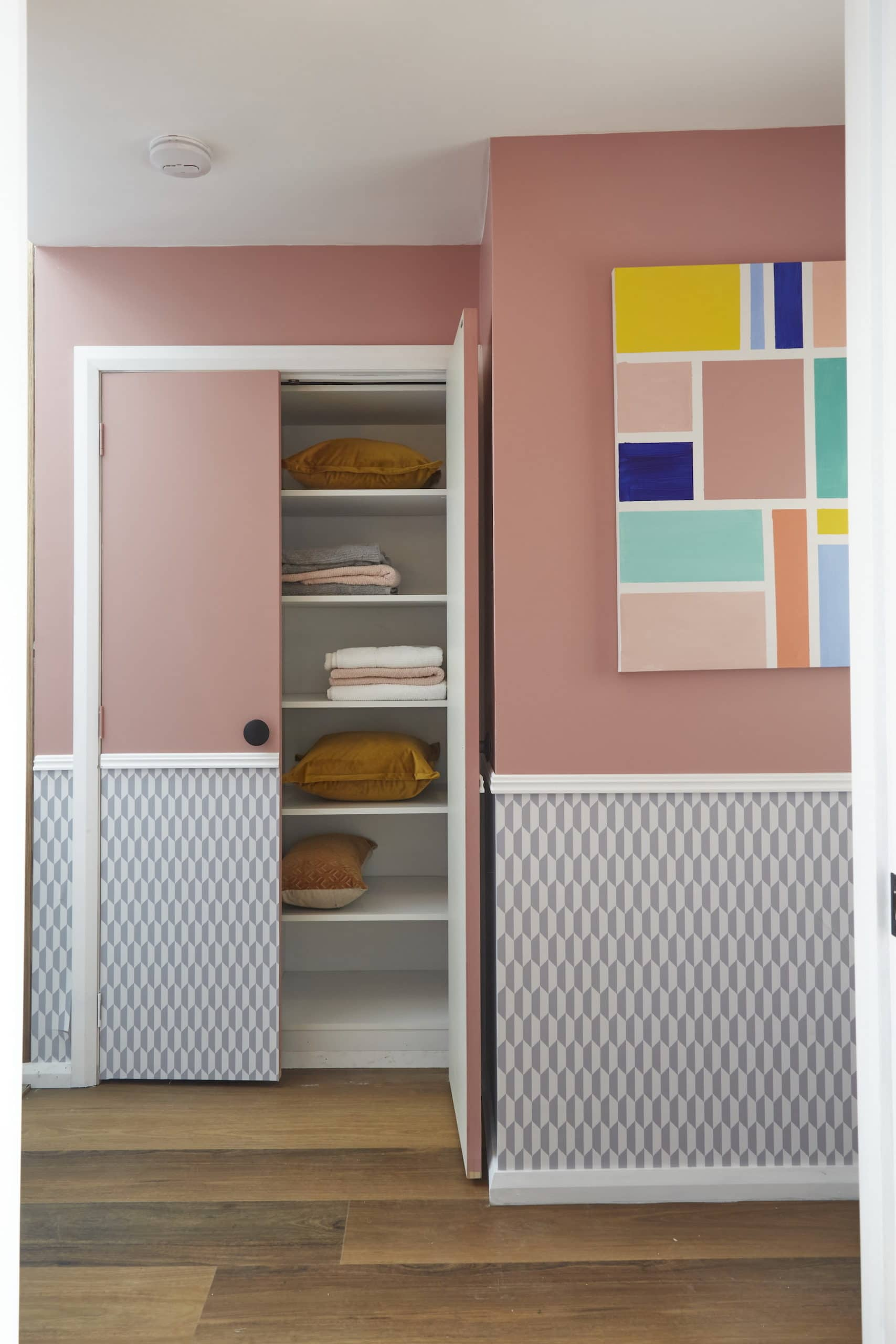 house rules 2020 kimmy and rhi hallway pink walls white wainscoting