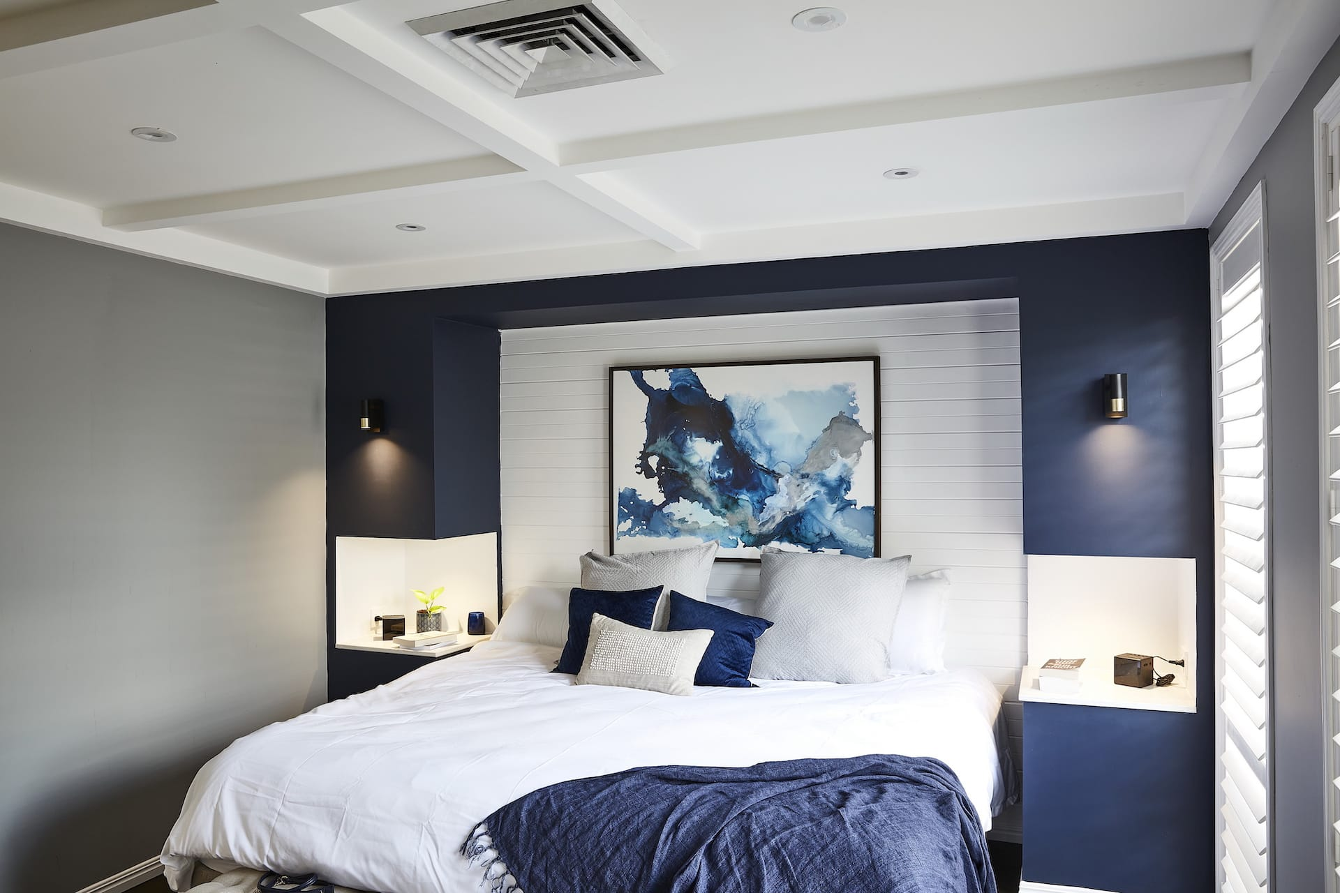 house rules 2020 lenore bedroom with navy blue feature wall
