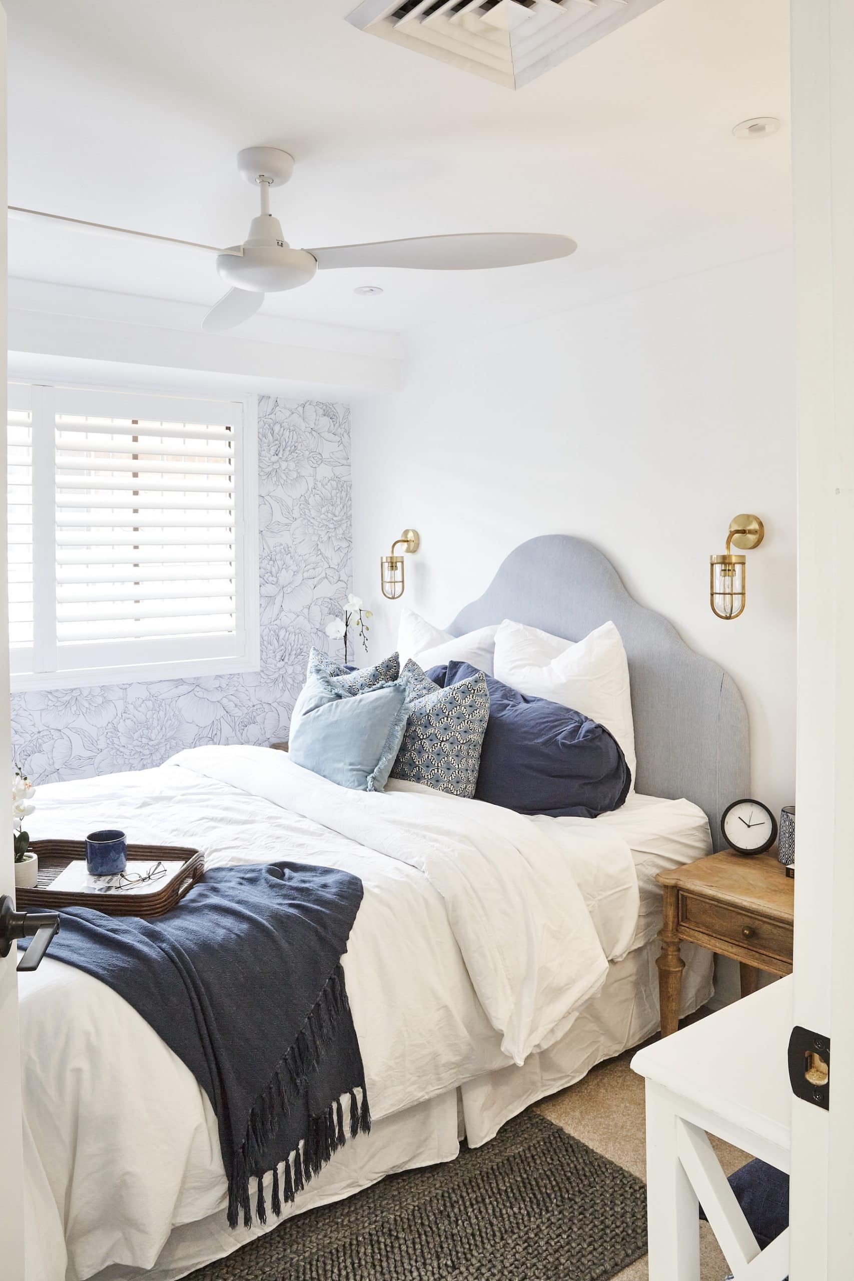 house rules 2020 lenore hamptons bedroom with black and white floral wallpaper and grey headboard
