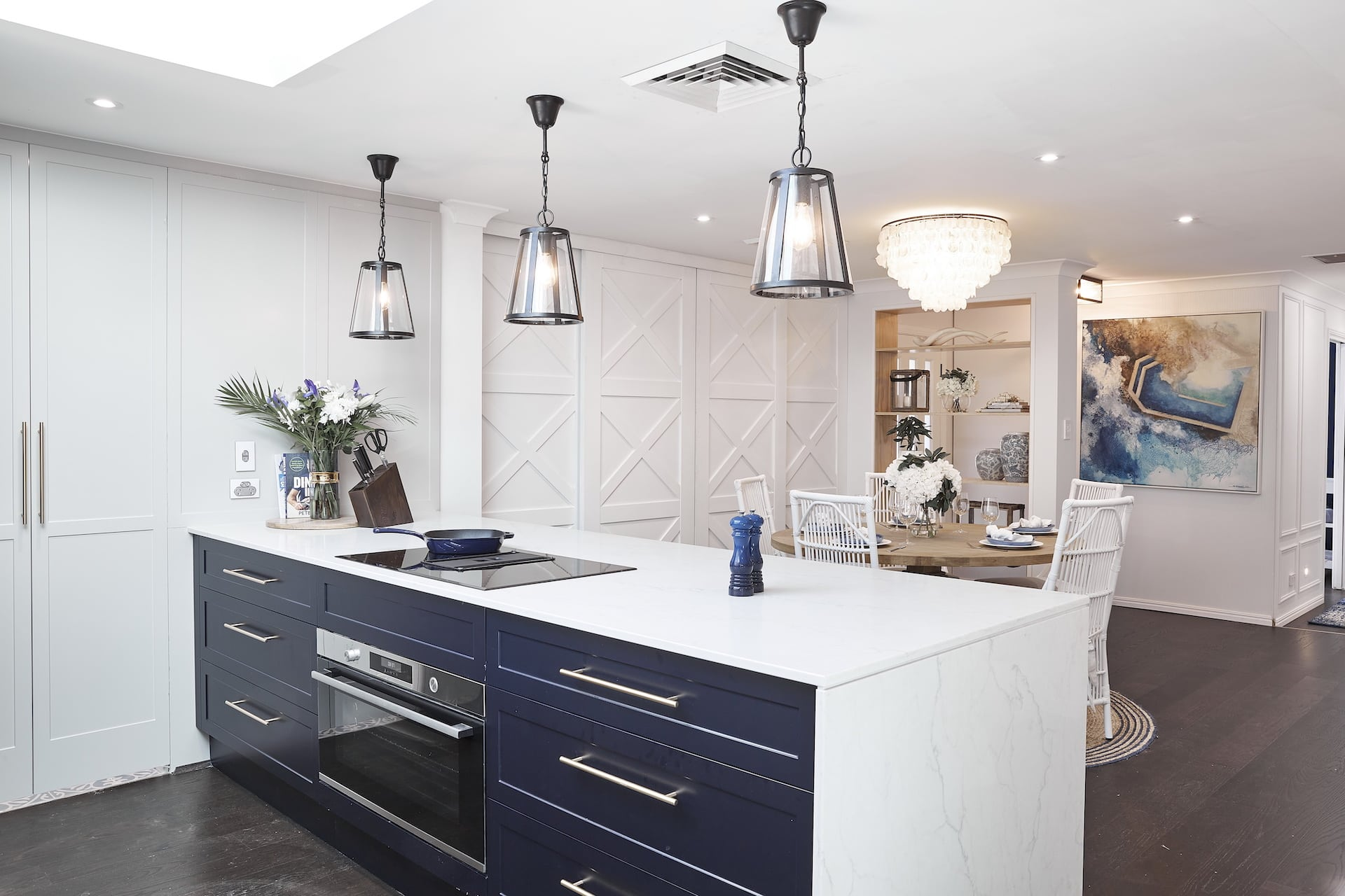 house rules 2020 lenore hamptons kitchen with navy blue cabinets
