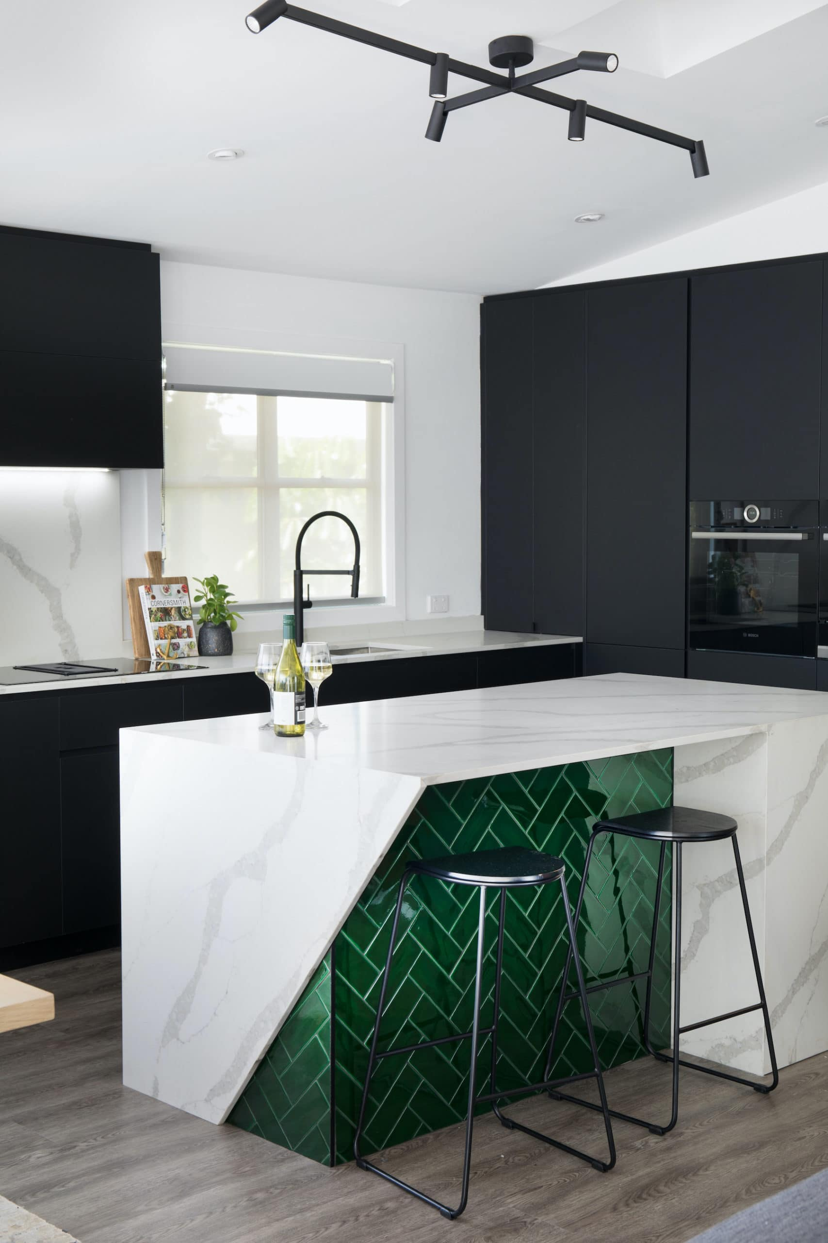 house rules 2020 tamara and rhys kitchen with black cabinetry and green tiles