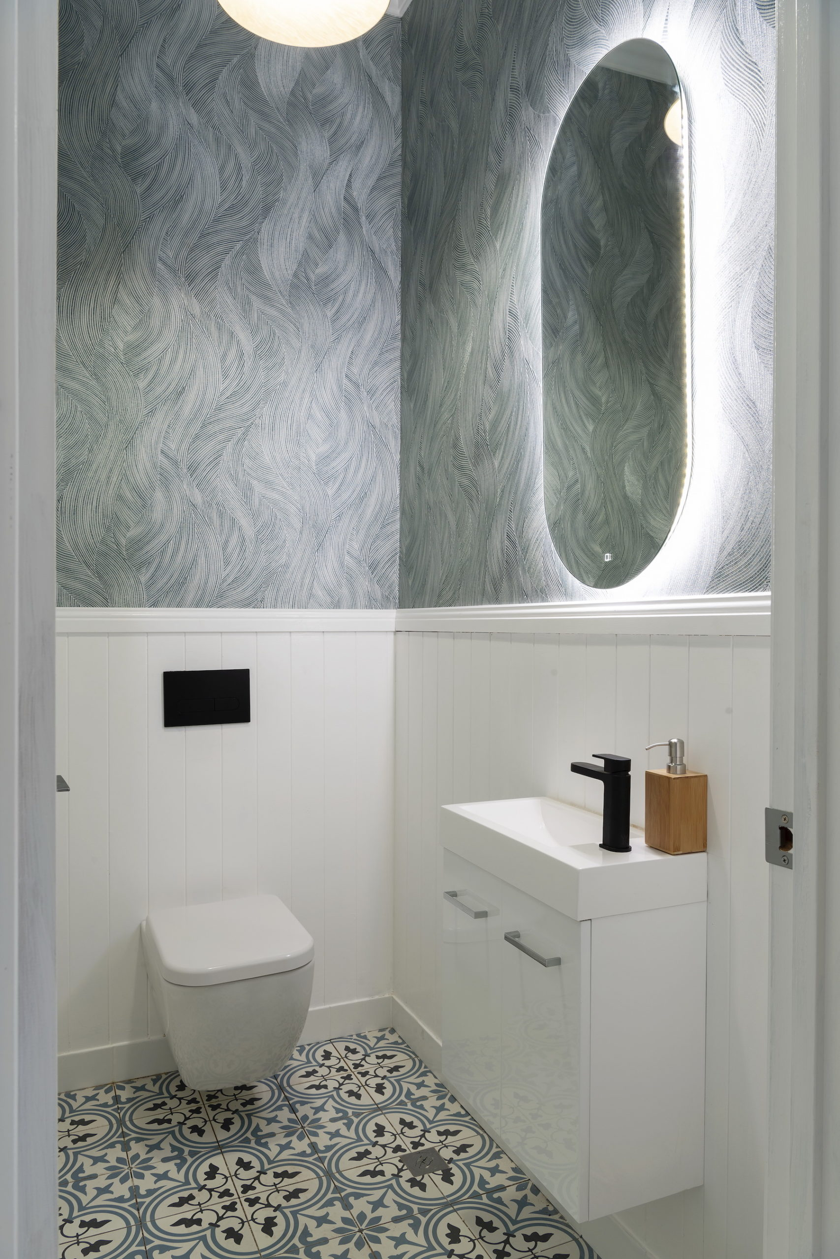 house rules 2020 tanya and dave reveal powder room with mosaic floor tiles and blue wallpaper