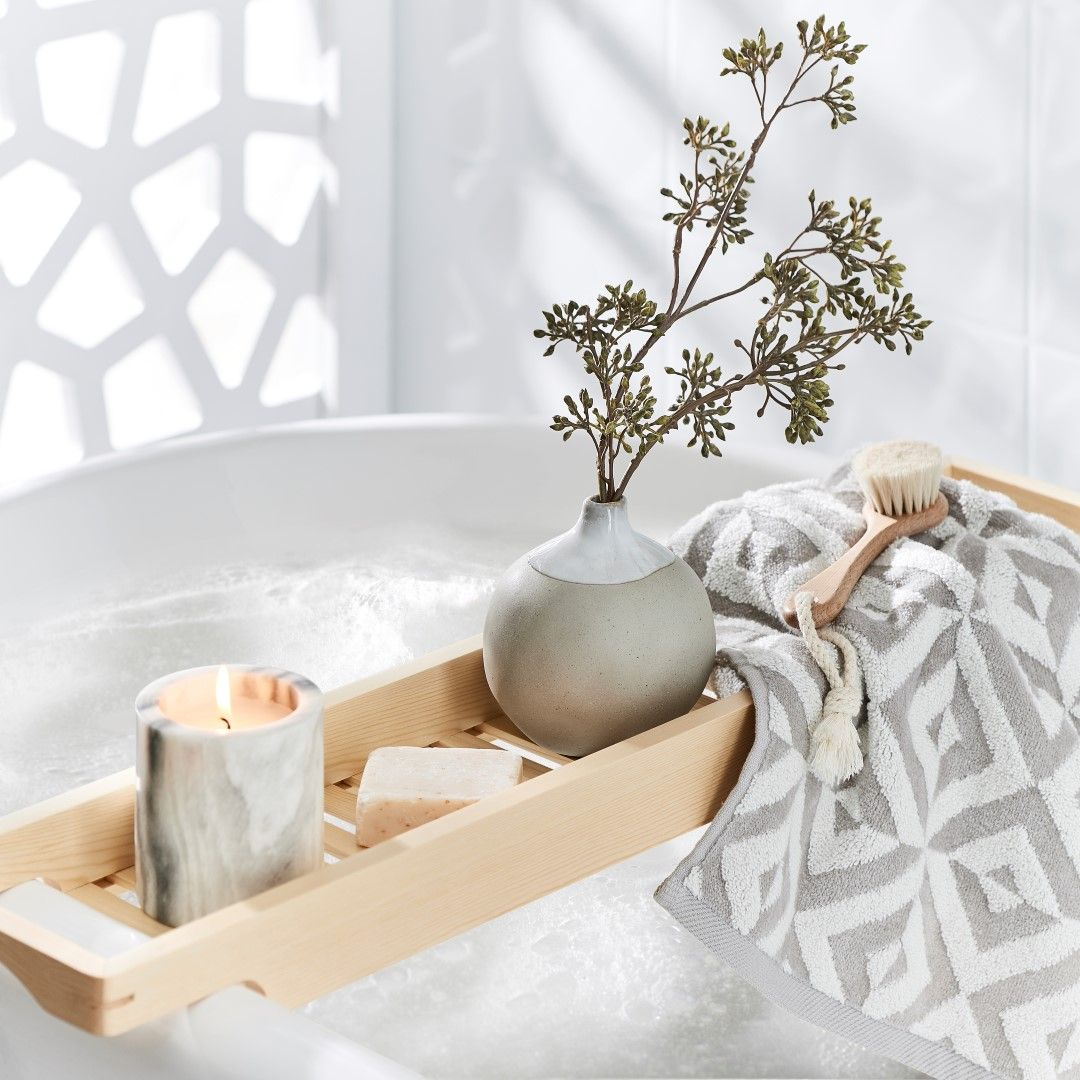 bed bath and table towel styling on bath caddy