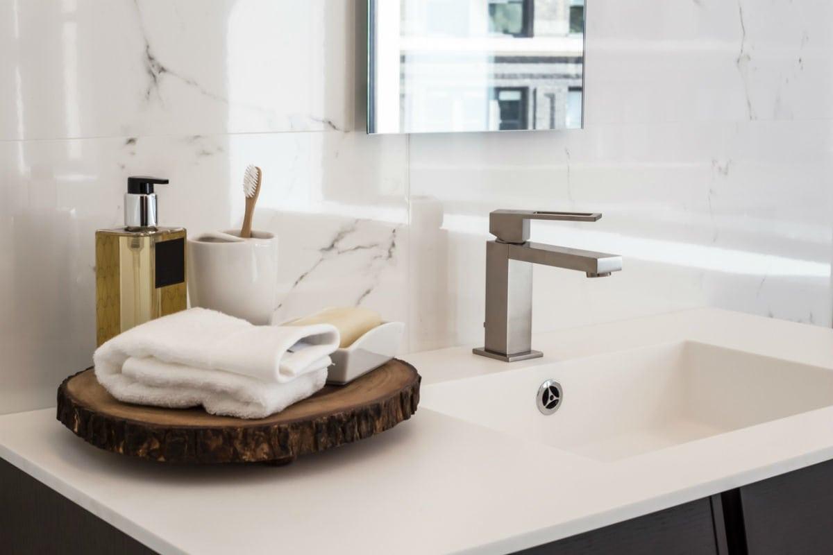 bob vila bathroom towel styling o n vanity with round wooden tray