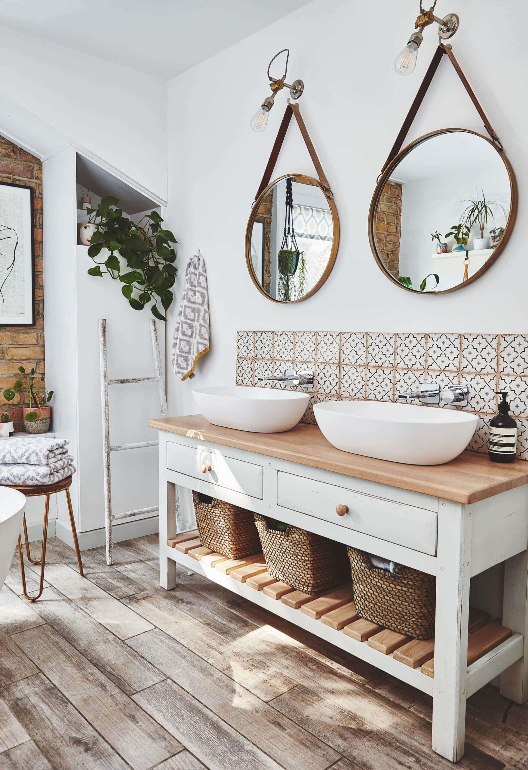 bohemian bathroom with towels in rattan baskets under vanity