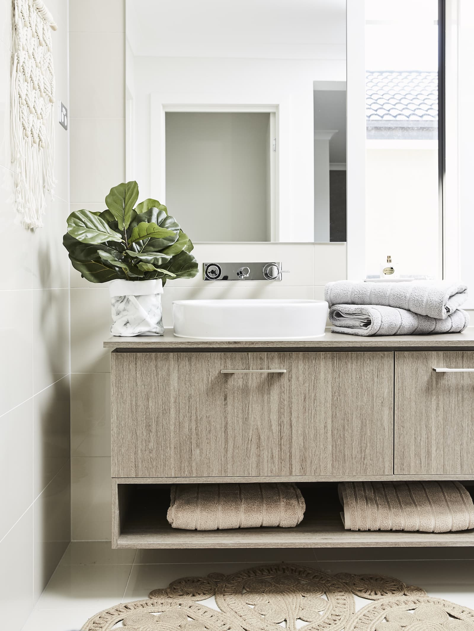 lorraine lea bathroom towel styling towels stacked on brown vanity