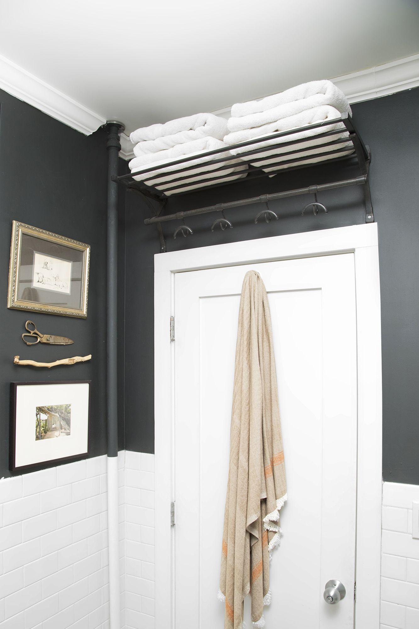towel styling on black metal shelf above bathroom door