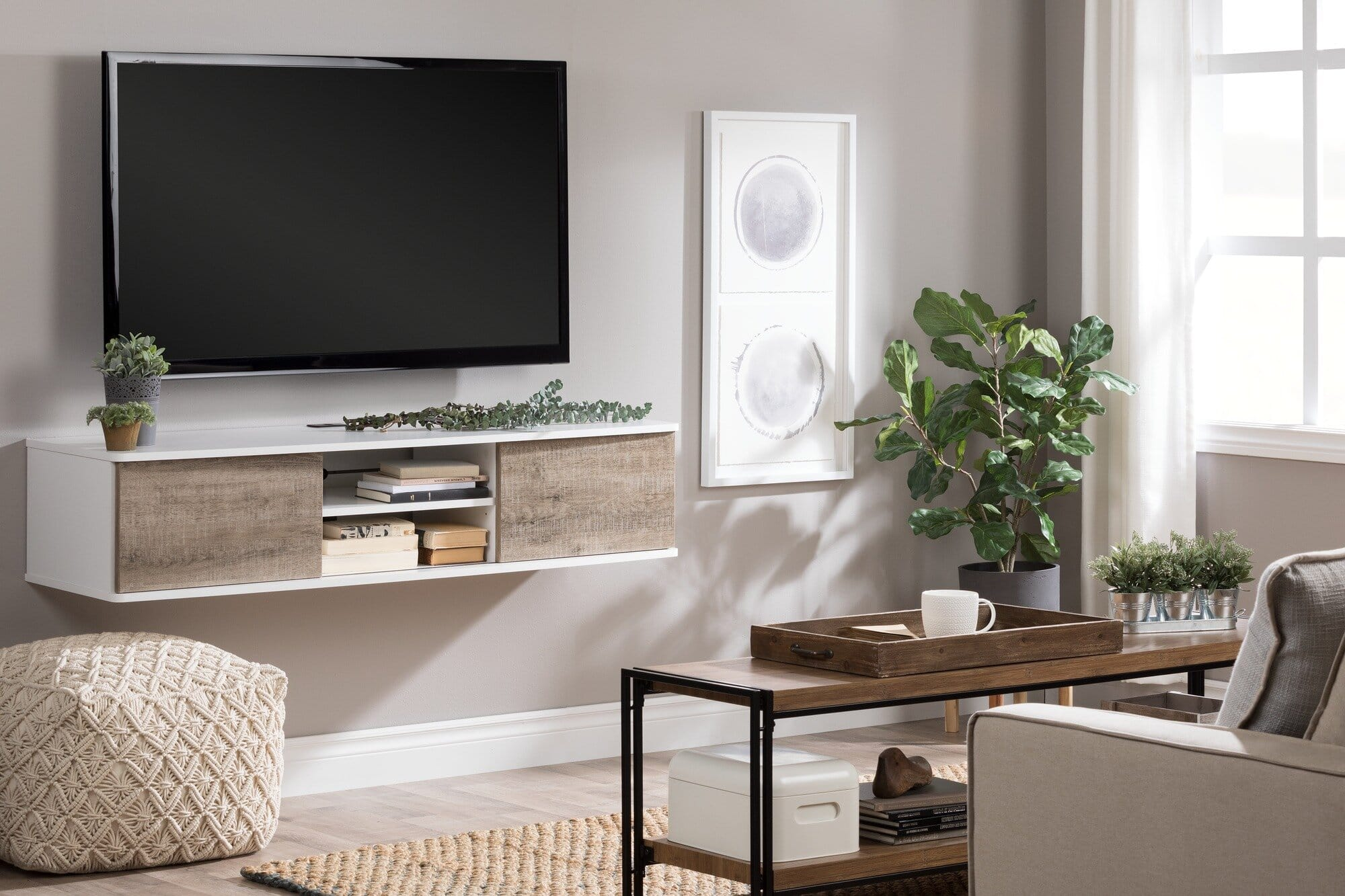 wall mounted tv above white and timber rustic entertainment unit