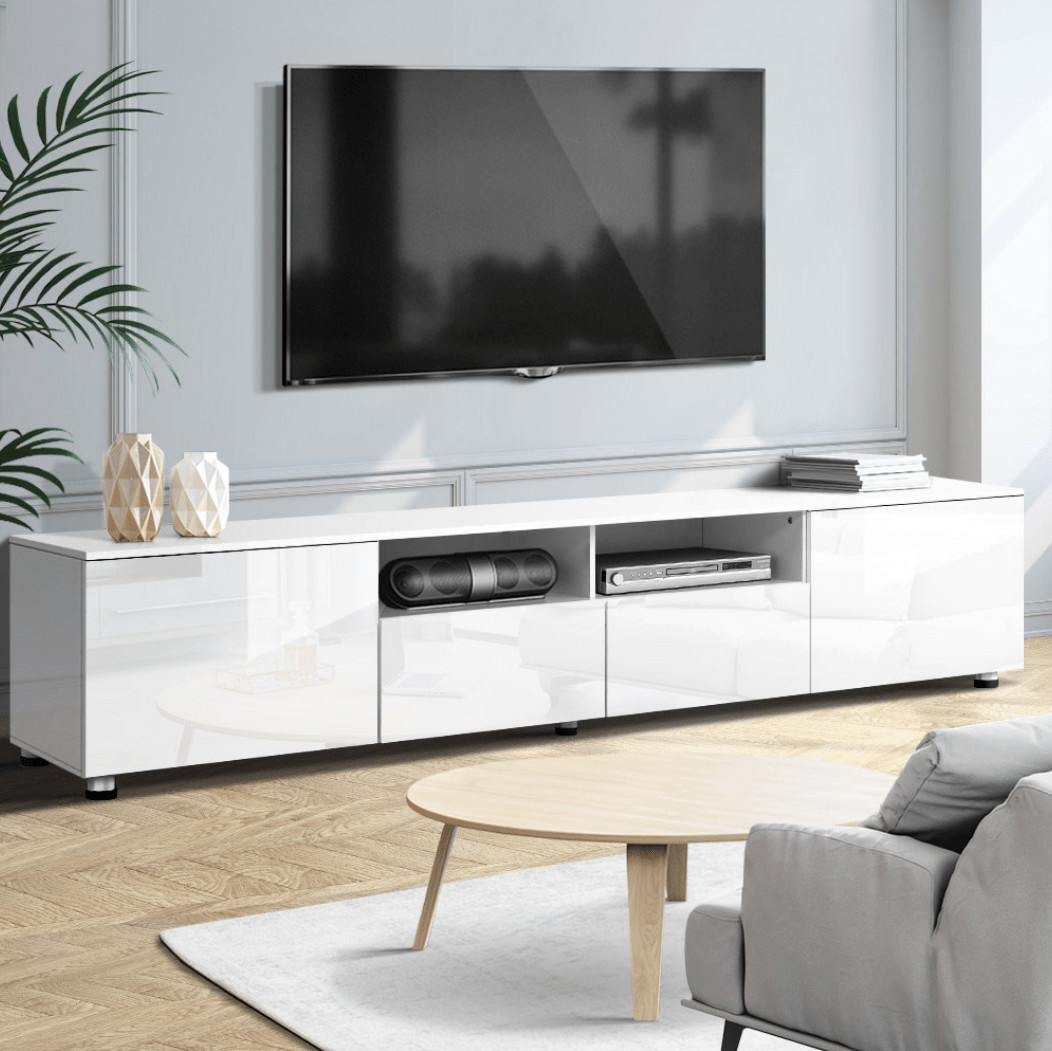 wall mounted tv above white entertainment unit