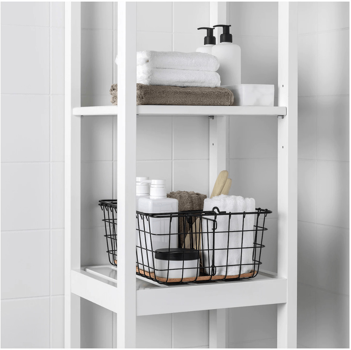 white ikea shelf in bathroom with styled towels in wire basket