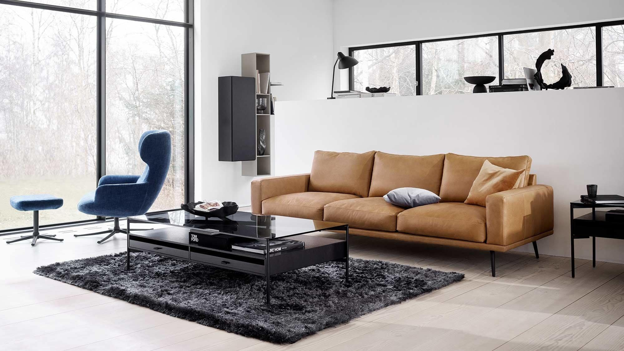 boconcet black rectangle coffee table in living room with tan leather sofa