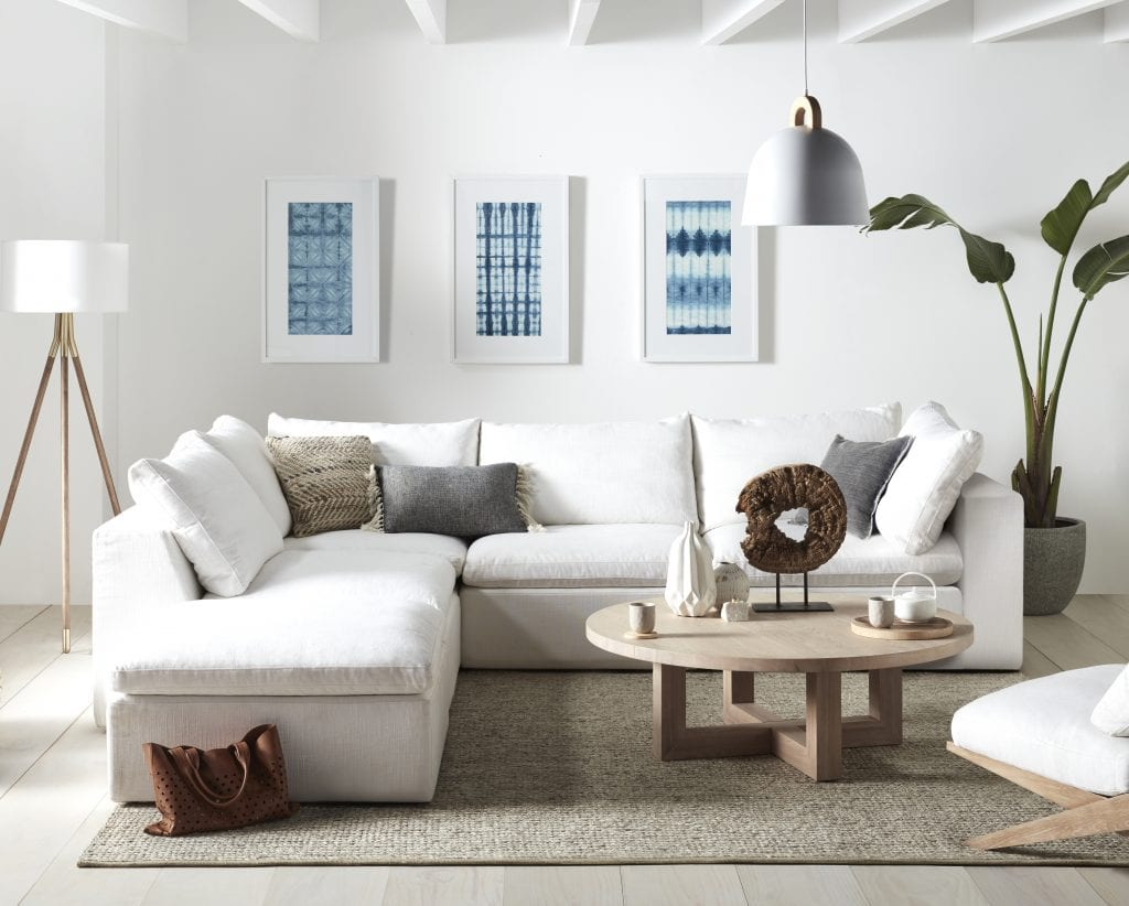 coastal living room with white sofa and round oak coffee table freedom