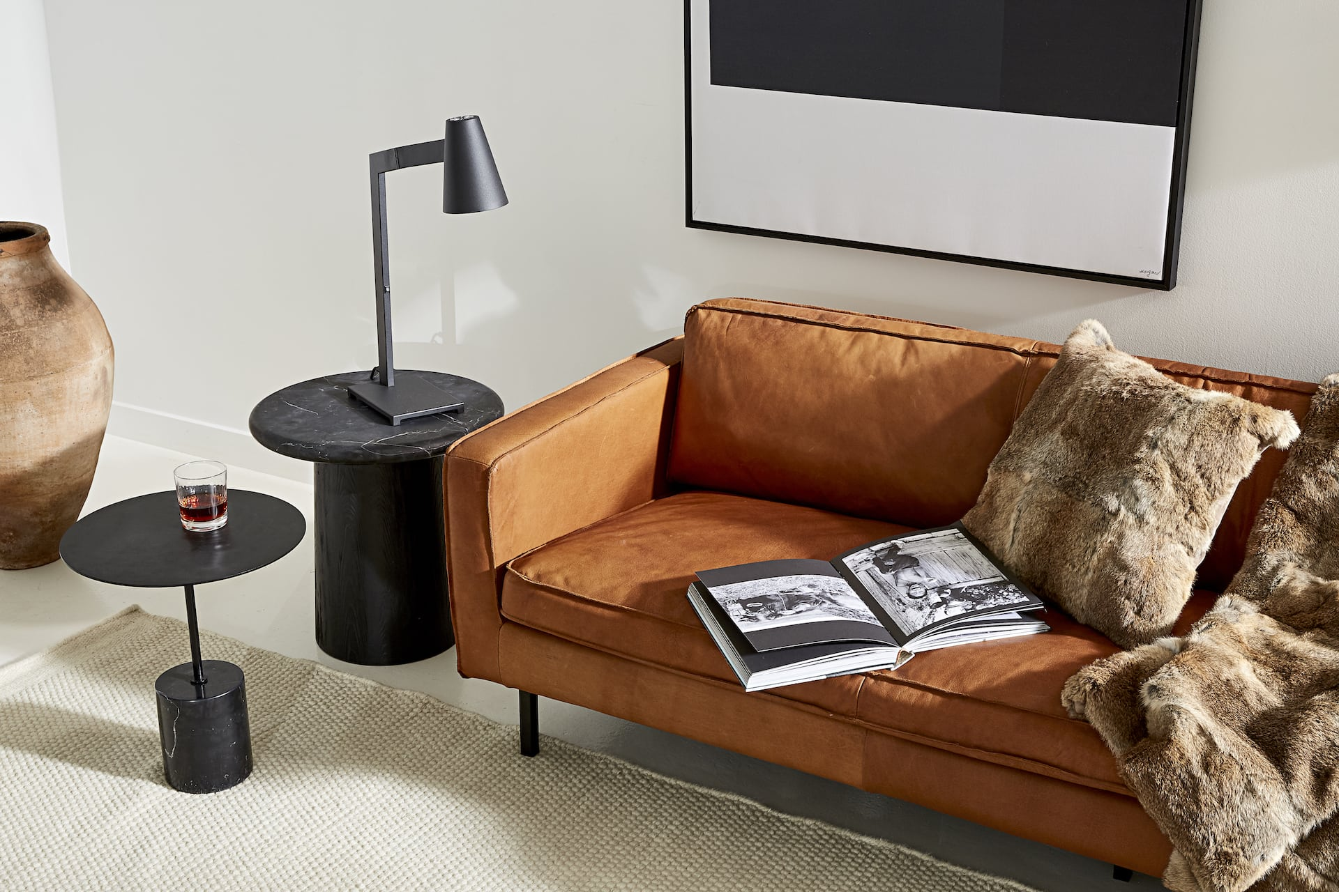 gaspard tan leather sofa from horgans with black side table luxe living room