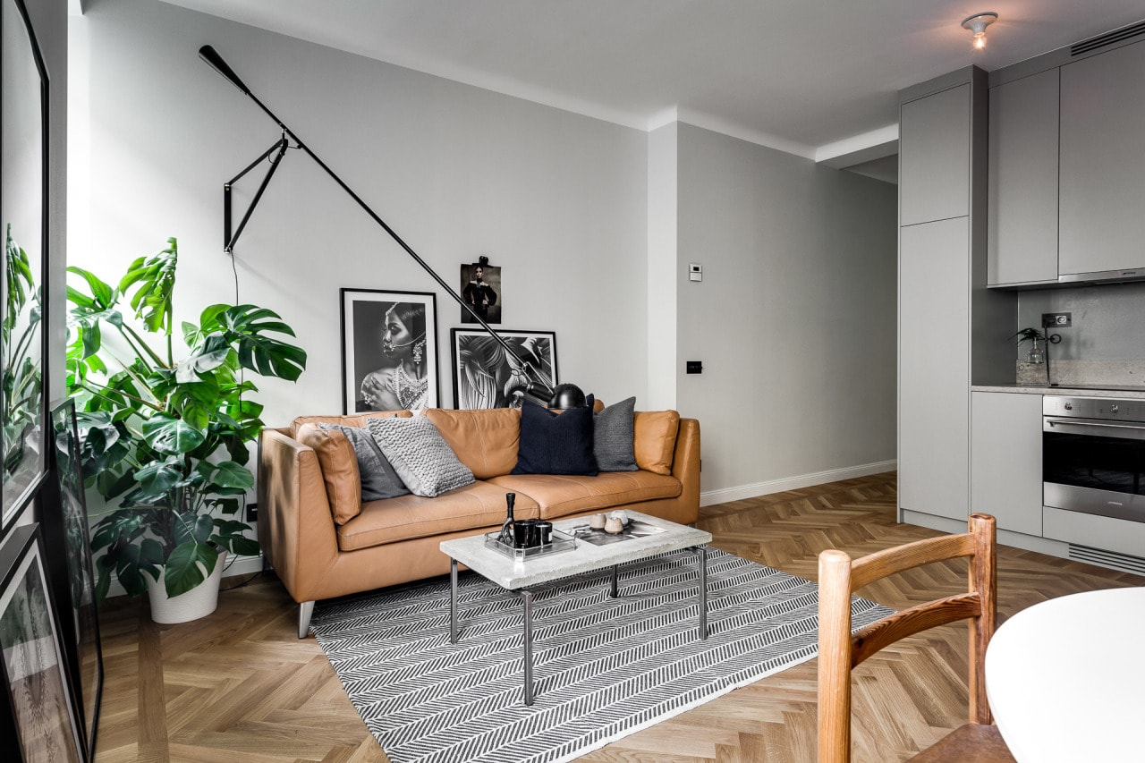 ikea stockholm brown leather sofa in small apartment