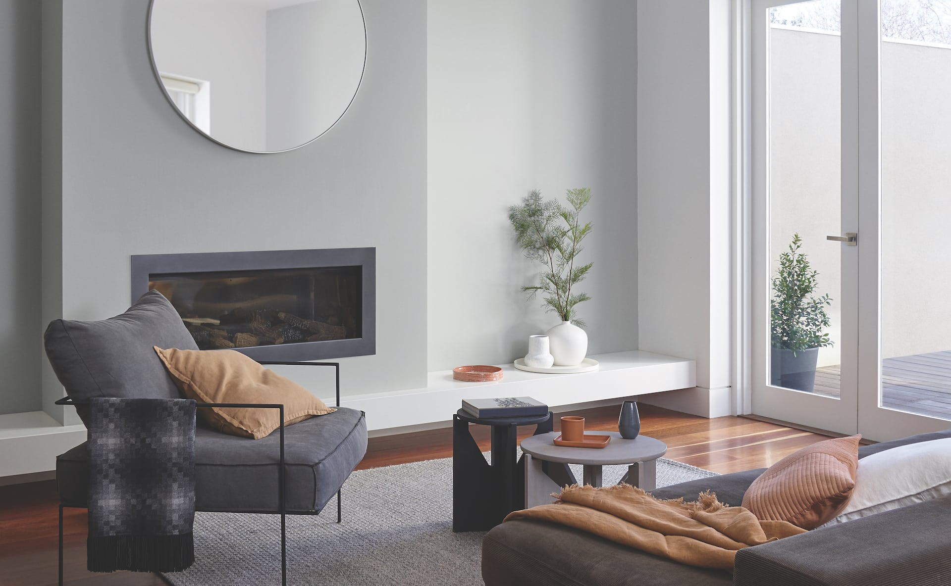 porters paint colours light grey living room with round mirror over fireplace