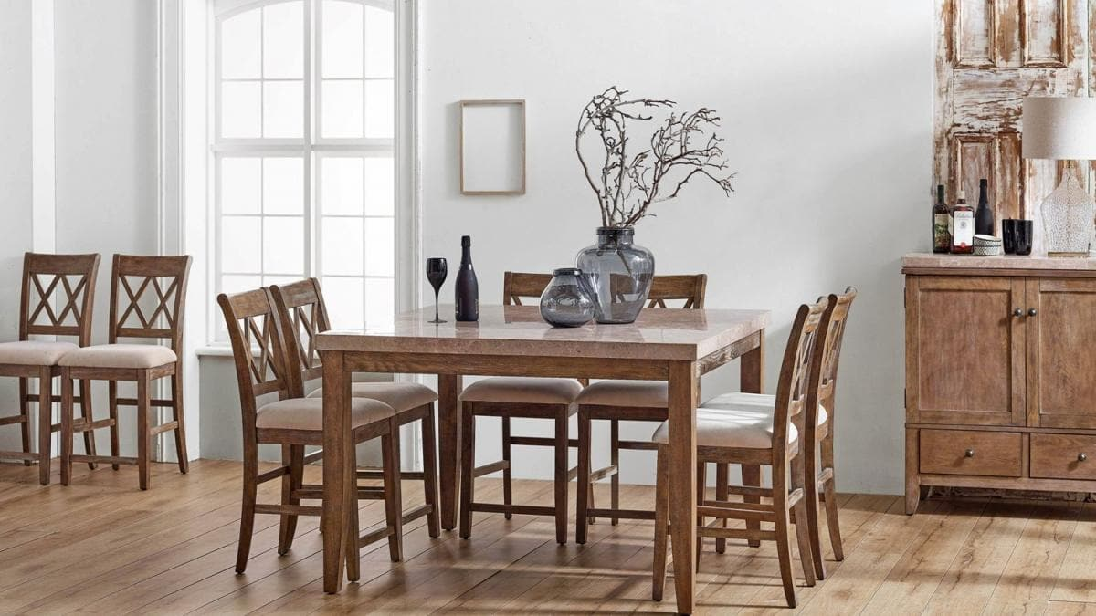 square timber dining table with round glass vases and twigs