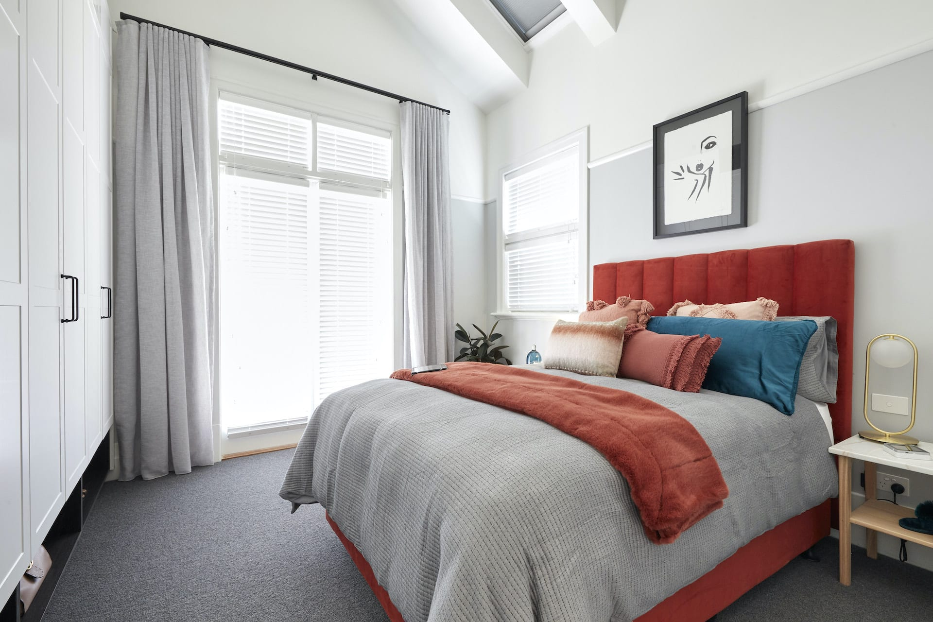 The Block 2020 Harry and Tash Guest Bedroom with red velvet headboard and grey bedding