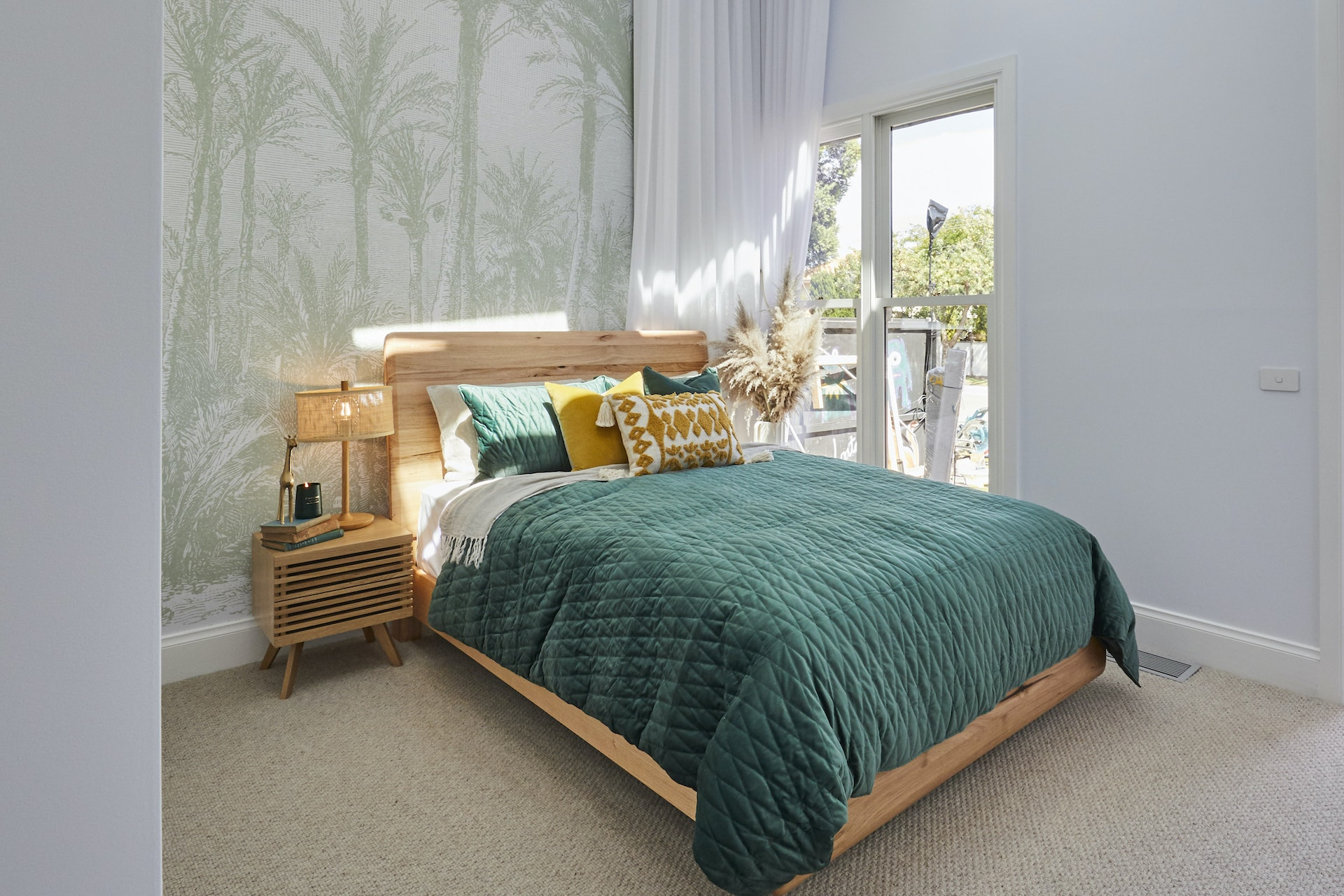 The Block 2020 Jimmy and Tam Guest Bedroom with palm tree wallpaper and emerald green bedding