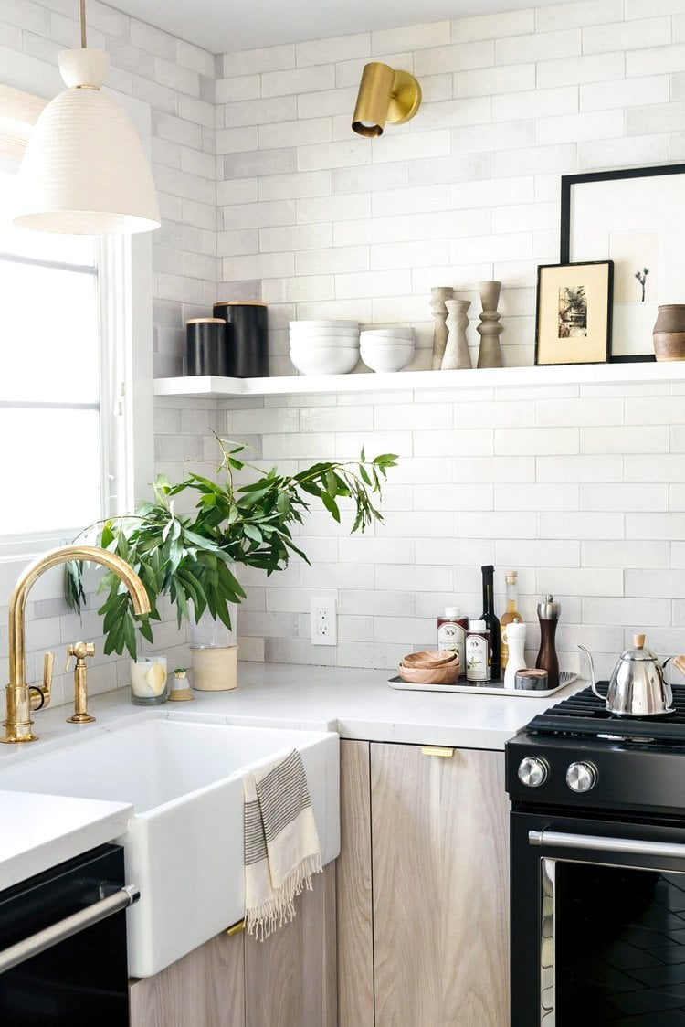 black and white kitchen with neutral decor and styling floating shelves