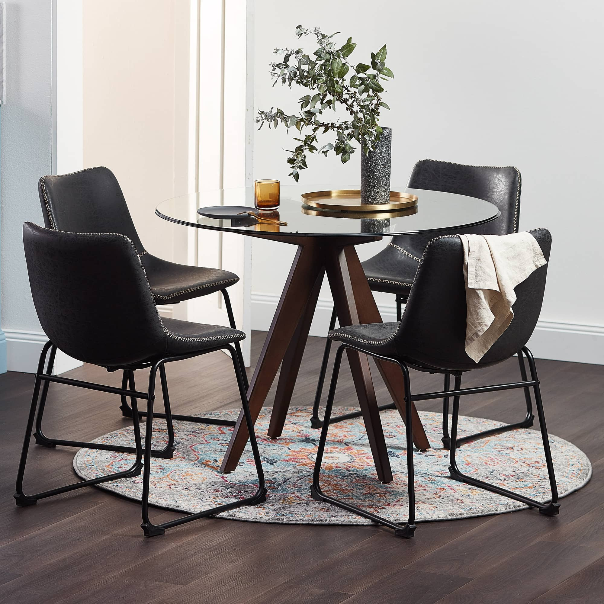 black leather dining chairs with round dining table in modern dining room