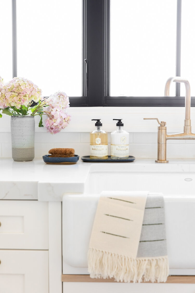 kitchen sink styling brass taps with soap and hand lotion