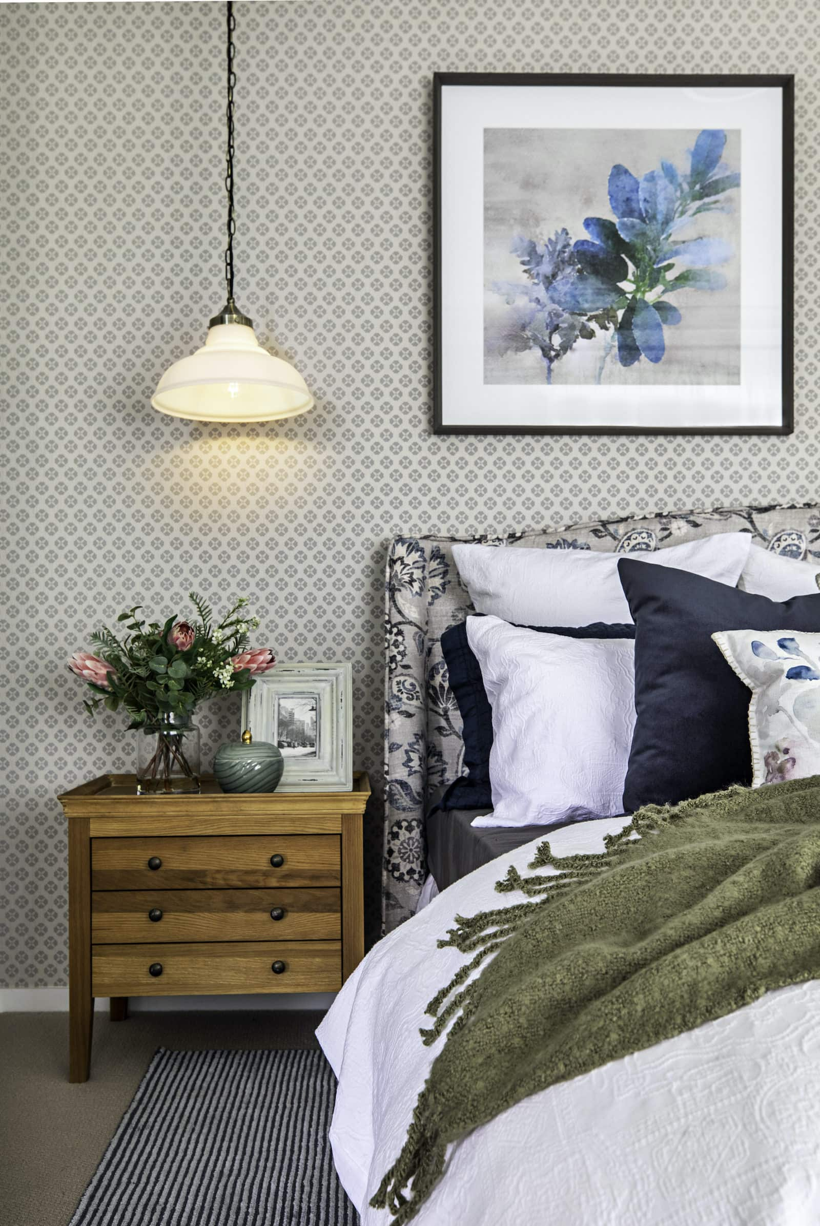 modern country bedroom with pattern fabric headboard and pattern wallpaper
