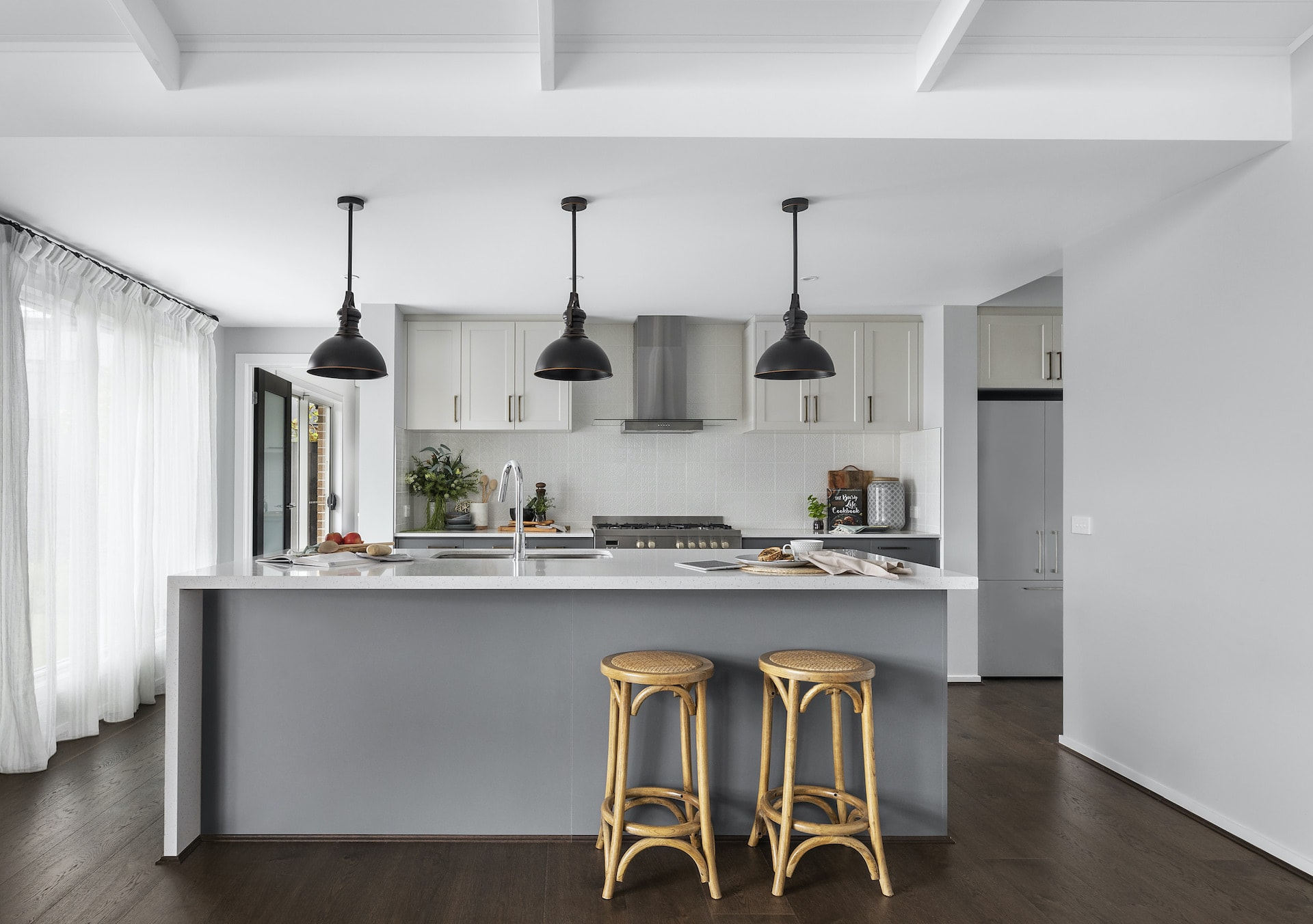 modern country kitchen with black industrial pendant lights over kitchen island