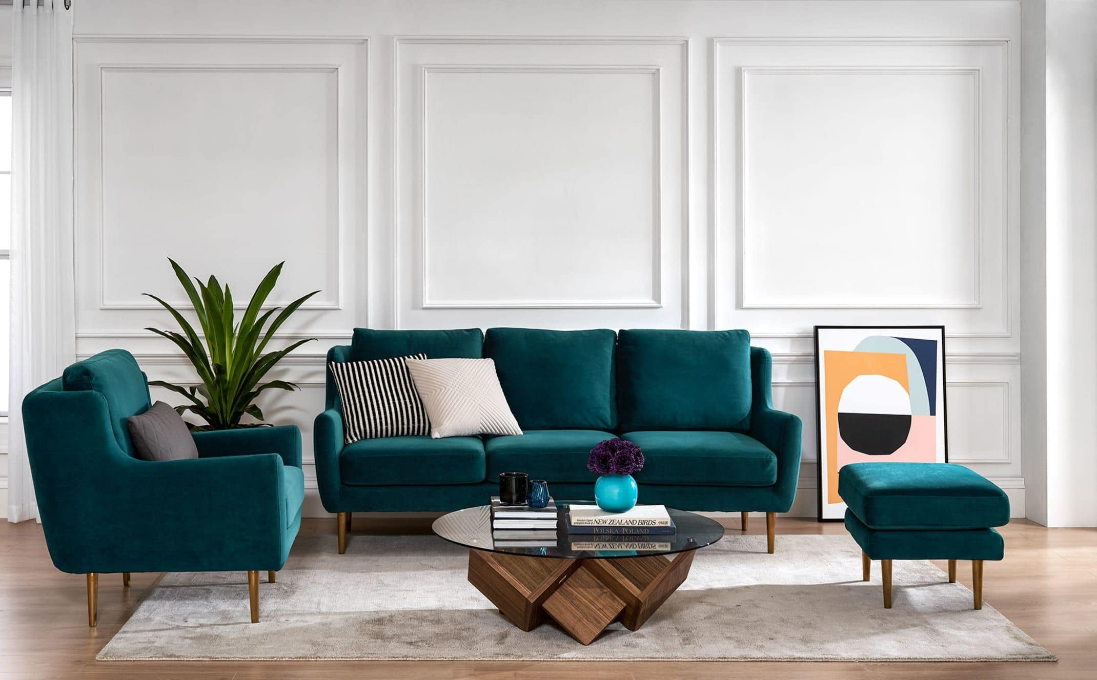 teal velvet sofa with gold legs in living room