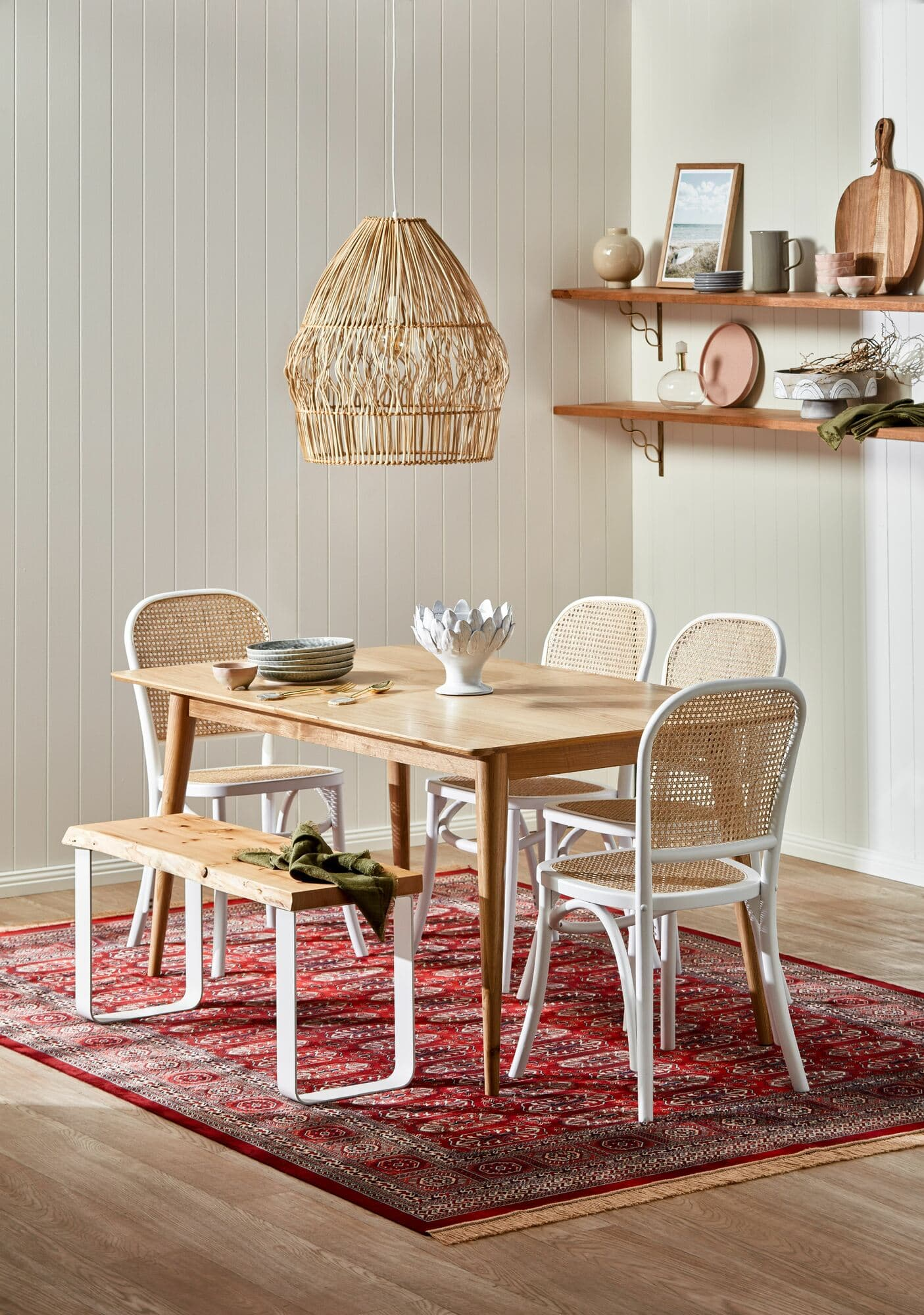 temple and webster dining room with rattan dining chairs and red rug