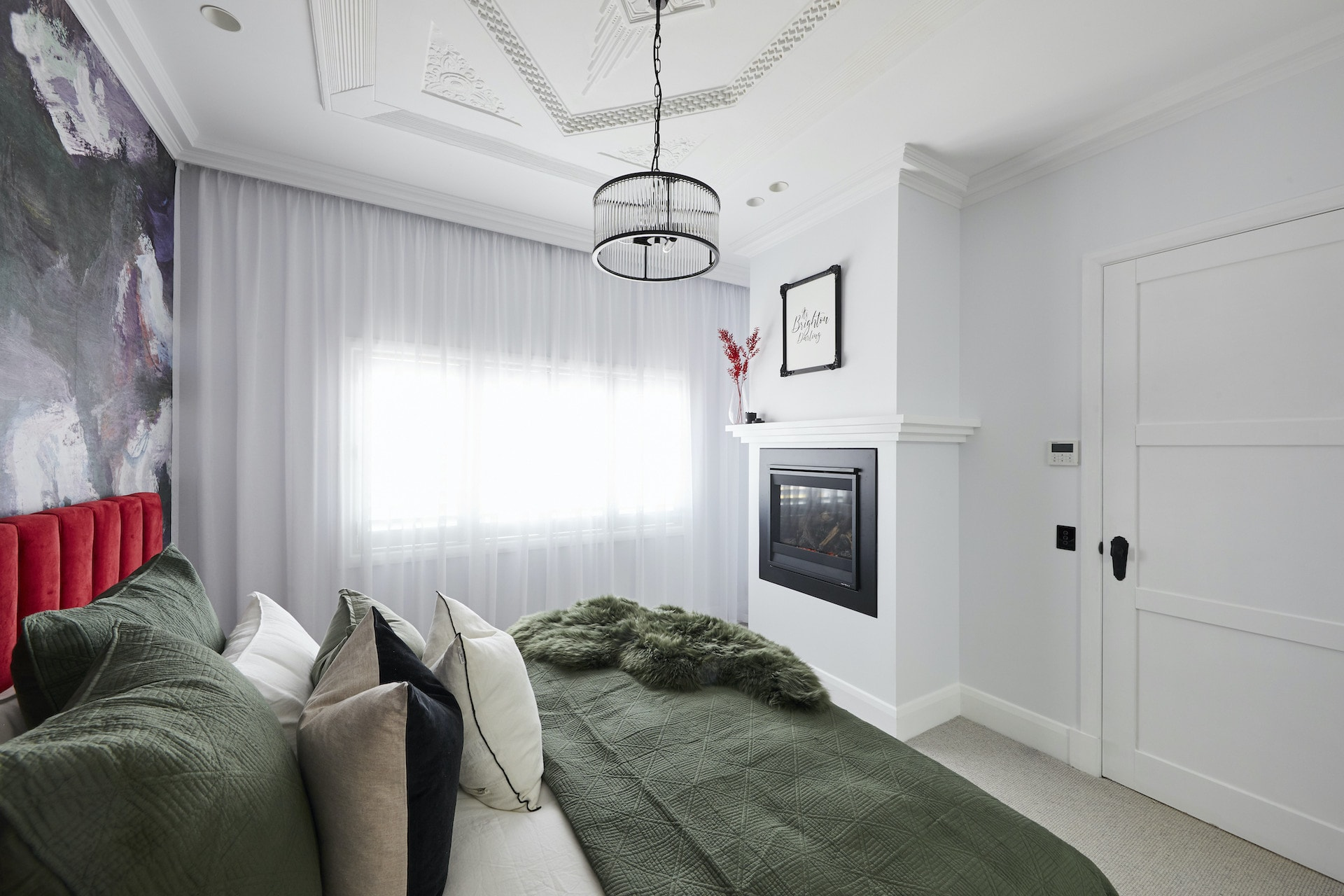 The Block 2020 master bedrooms bedroom with fireplace and dark grey carpet