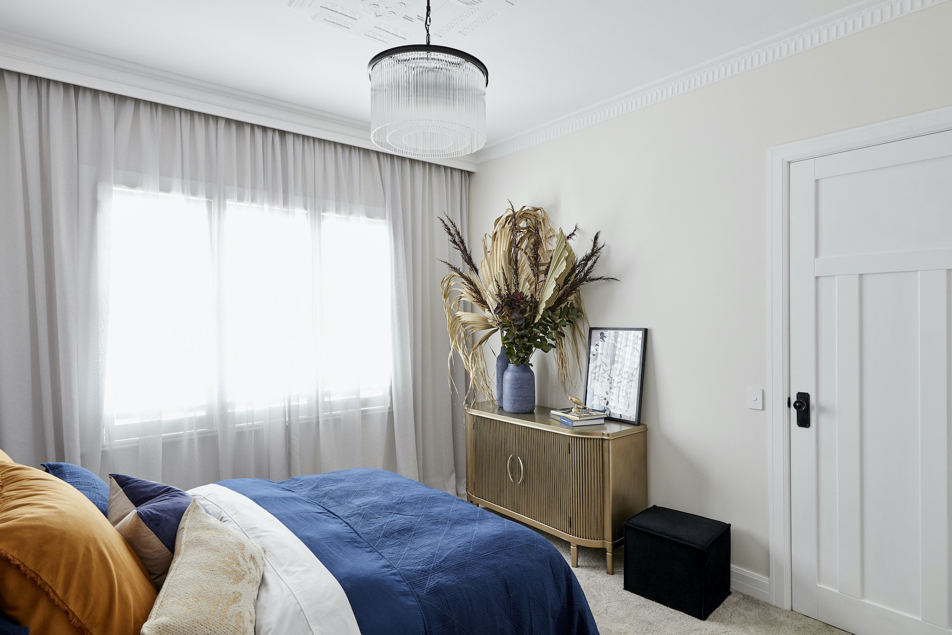 The Block 2020 master bedrooms daniel jade bedroom with blue bedding and gold sideboard