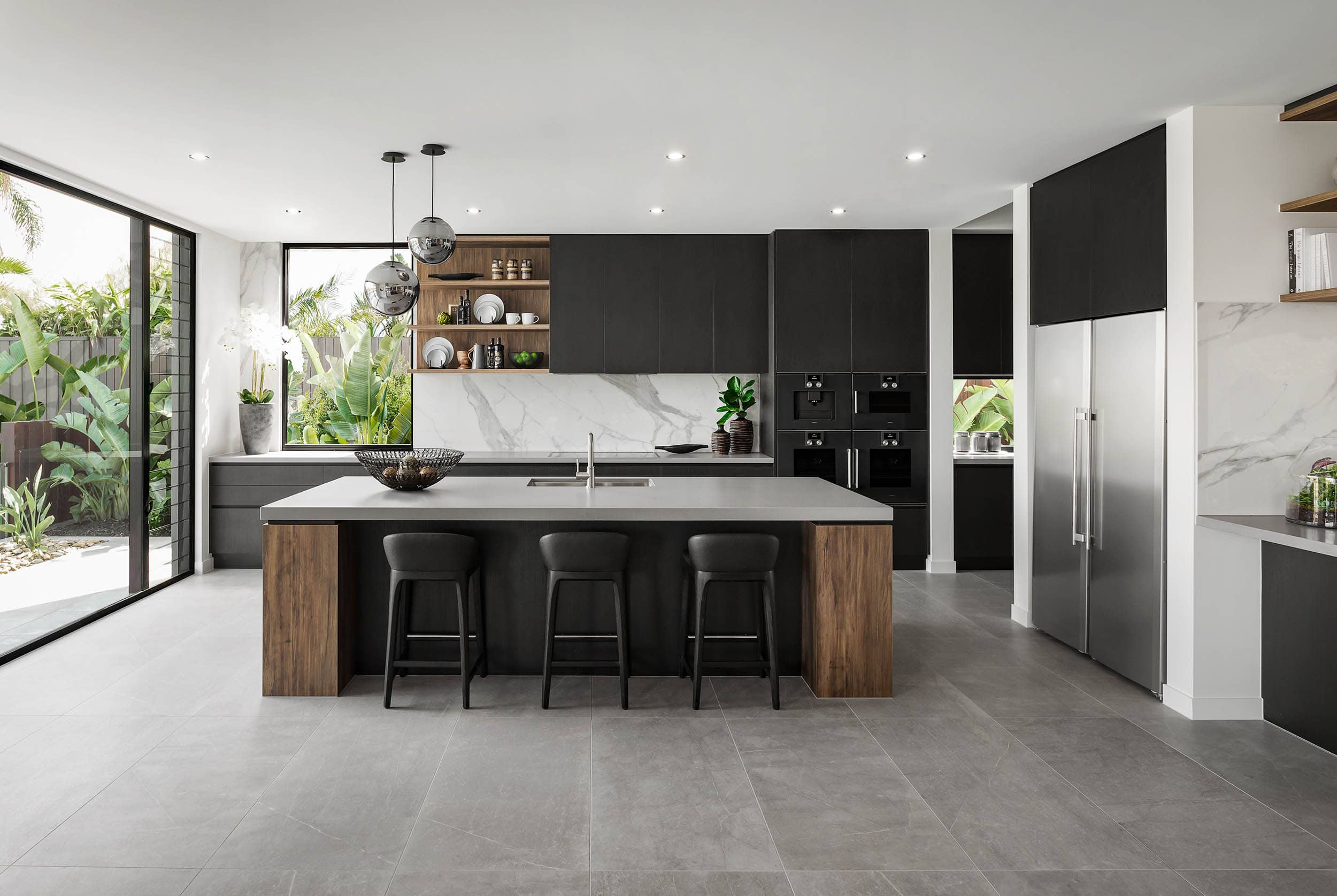 black and brown modern industrial kitchen design with grey floor tiles