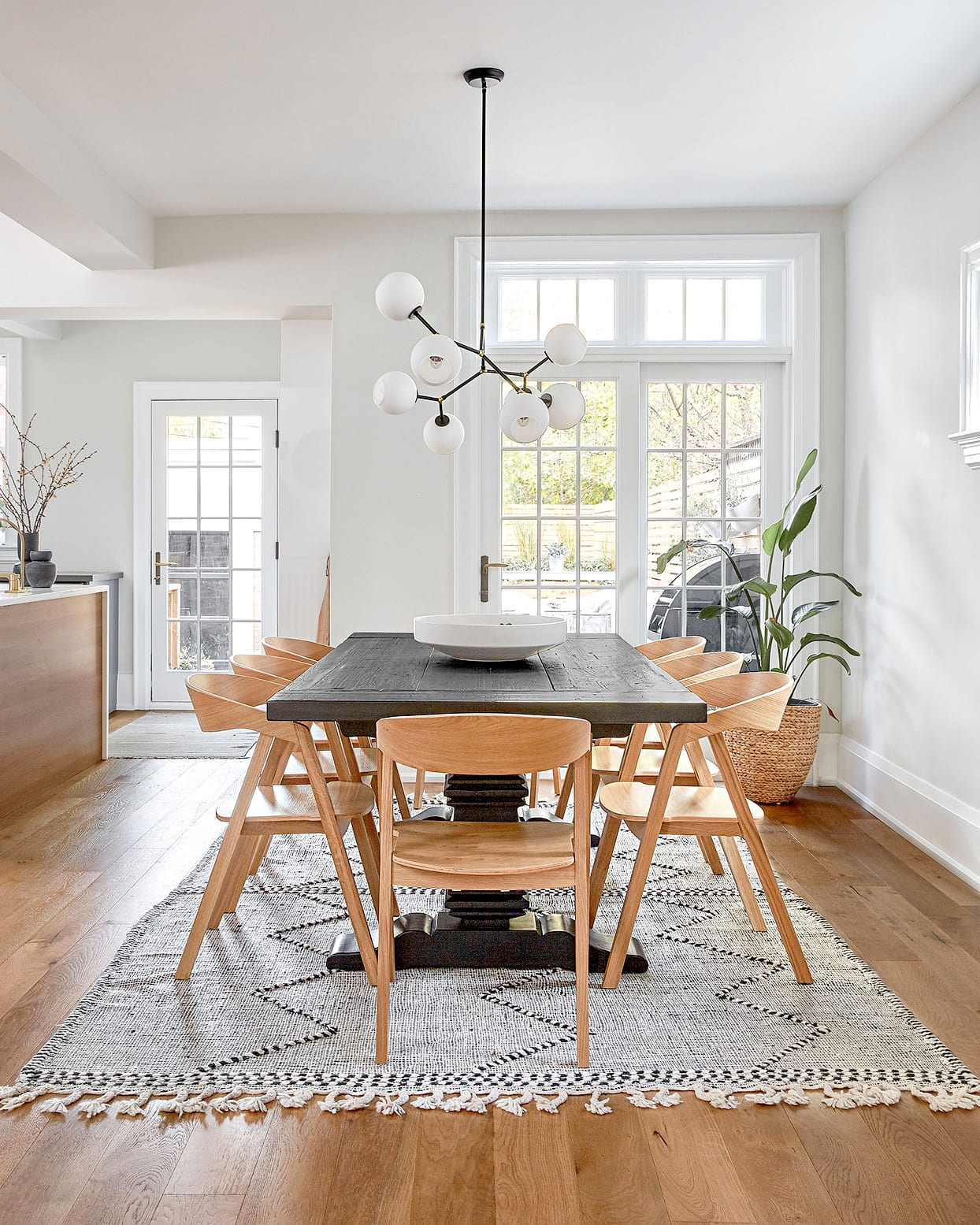 california cool dining room with provincial dining table and mid century multi bulb pendant