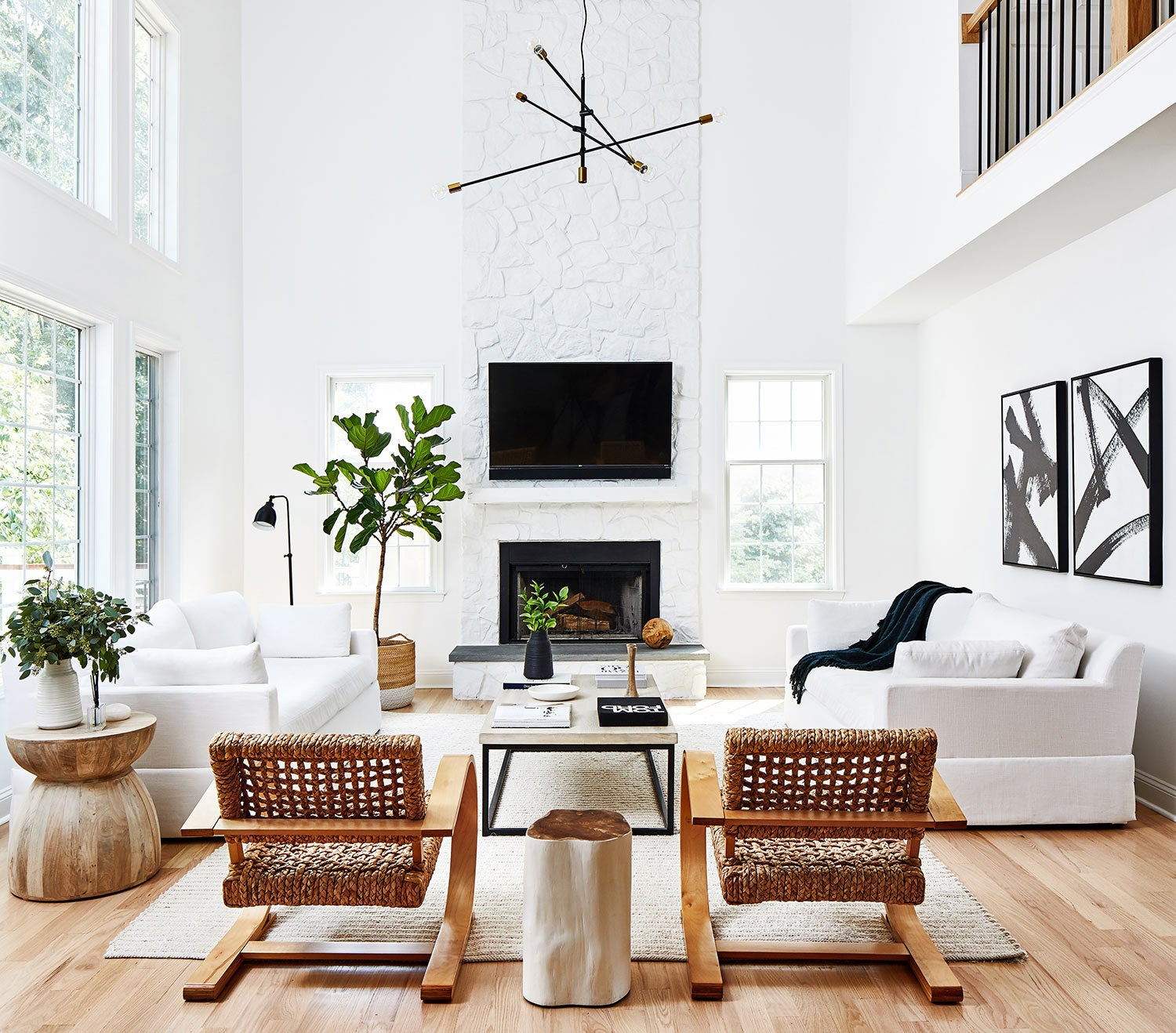 california cool interior design living room with white brick fireplace and mid century pendant