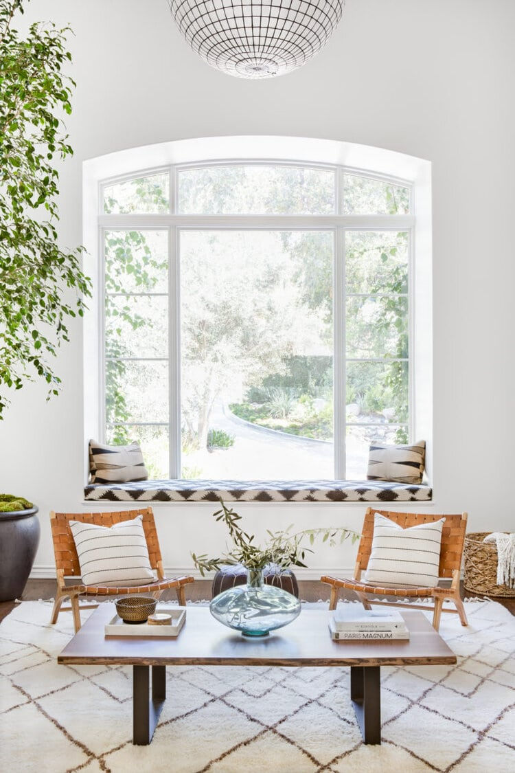 california cool living room with woven leather armchairs and mid century pendant