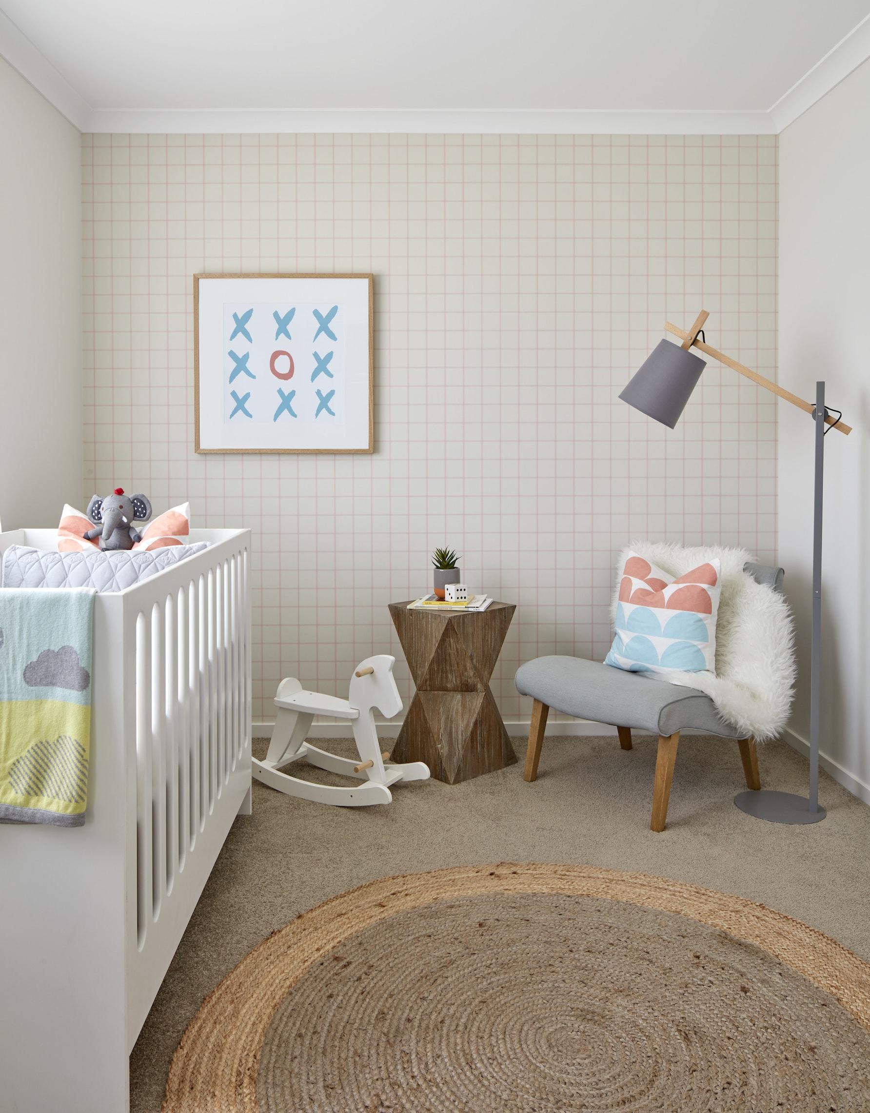 colourful gender neutral nursery design with orange grid wallpaper and round jute rug