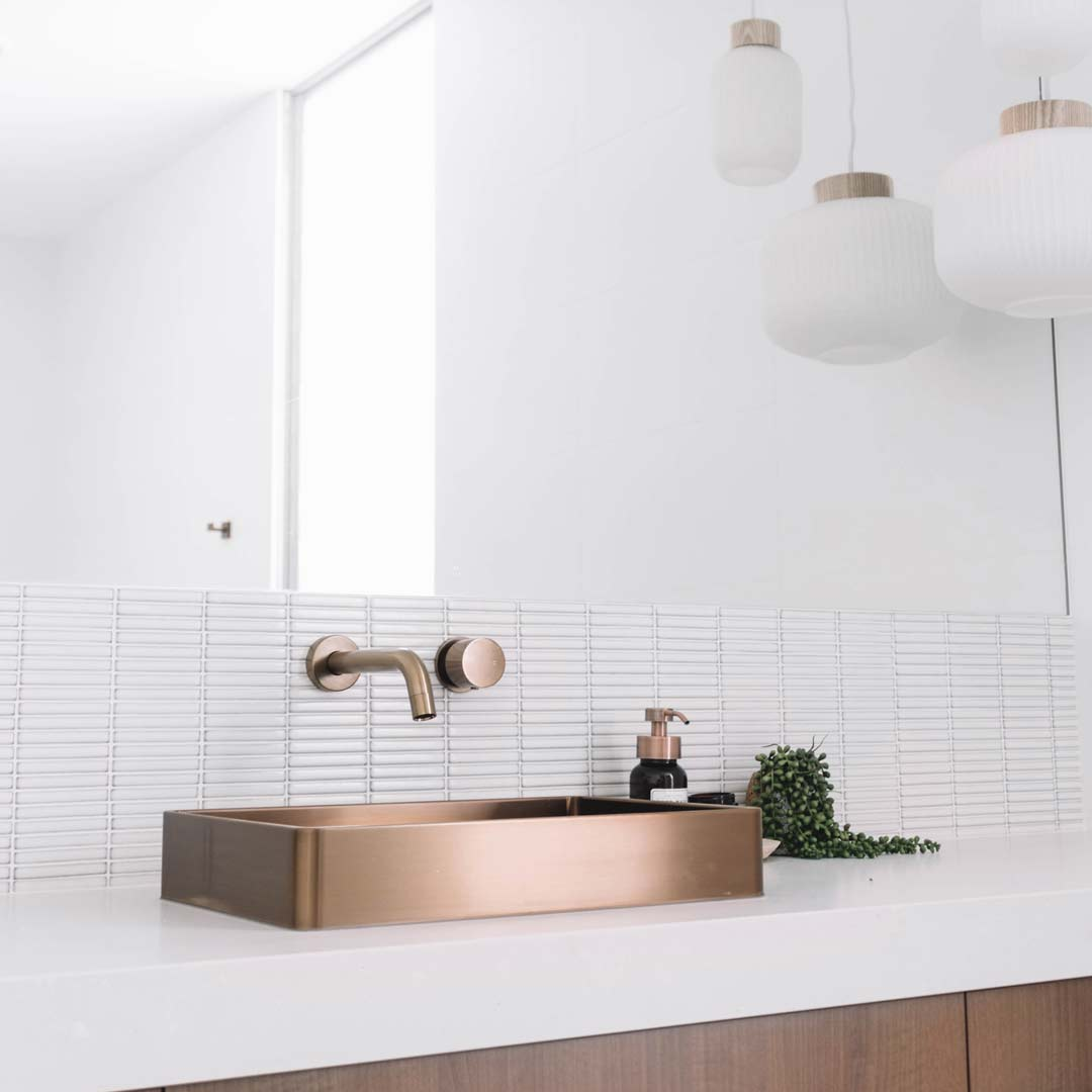 copper coloured bathroom basin on white vanity with matching tap abi interiors