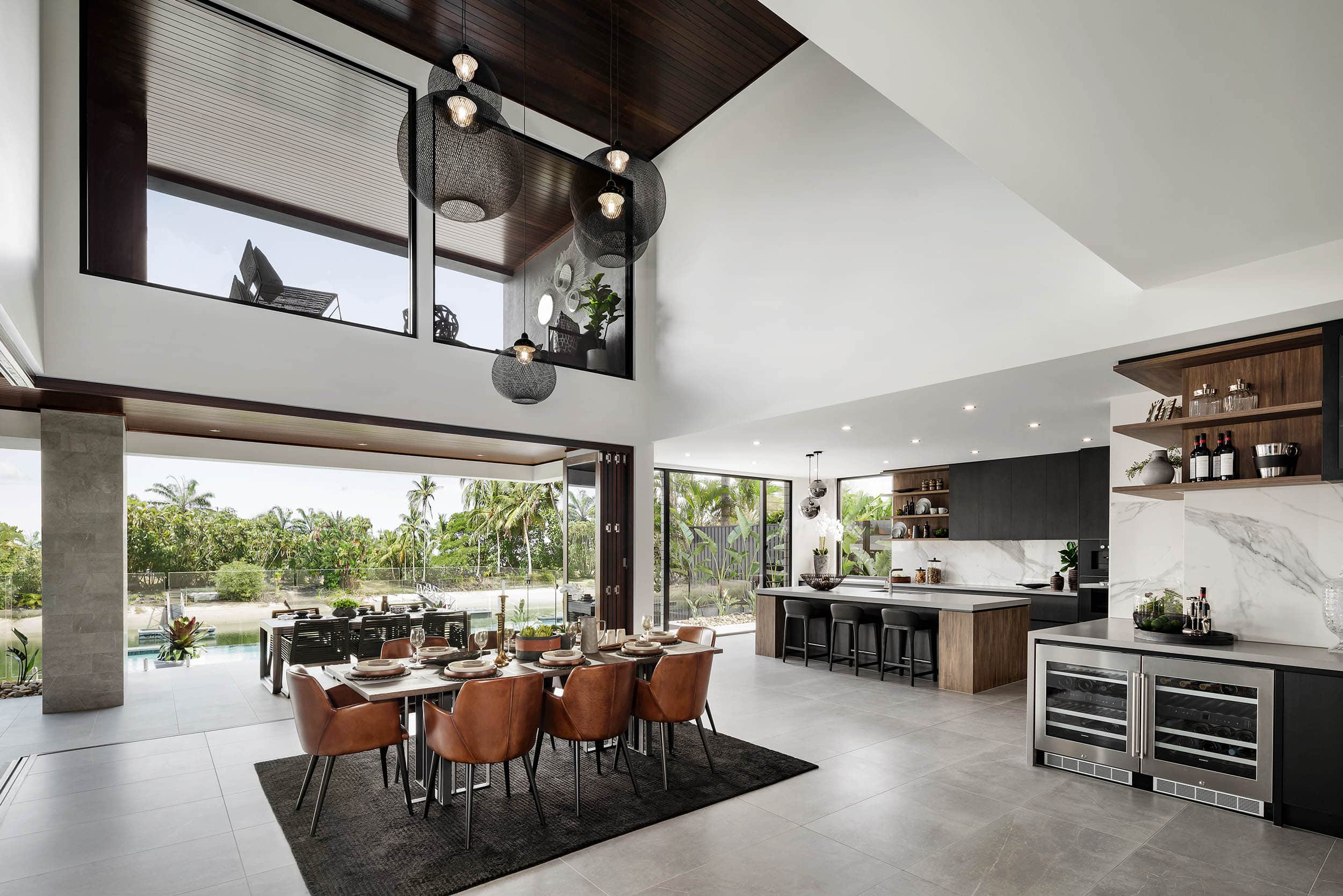 dark moody dining room with tan leather dining chairs and black rug brown timber dining table