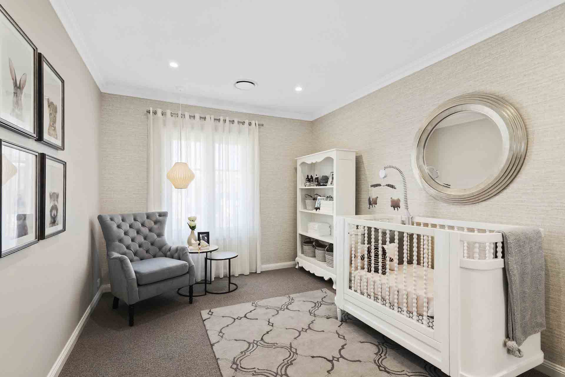 gender neutral nursery design white white baby furniture and grey tufted armchair in corner