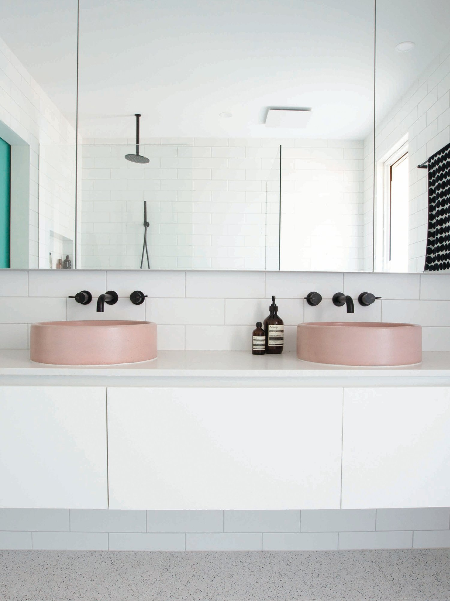 hemsley bath shoppe round pink coloured bathroom basin in white bathroom with black taps
