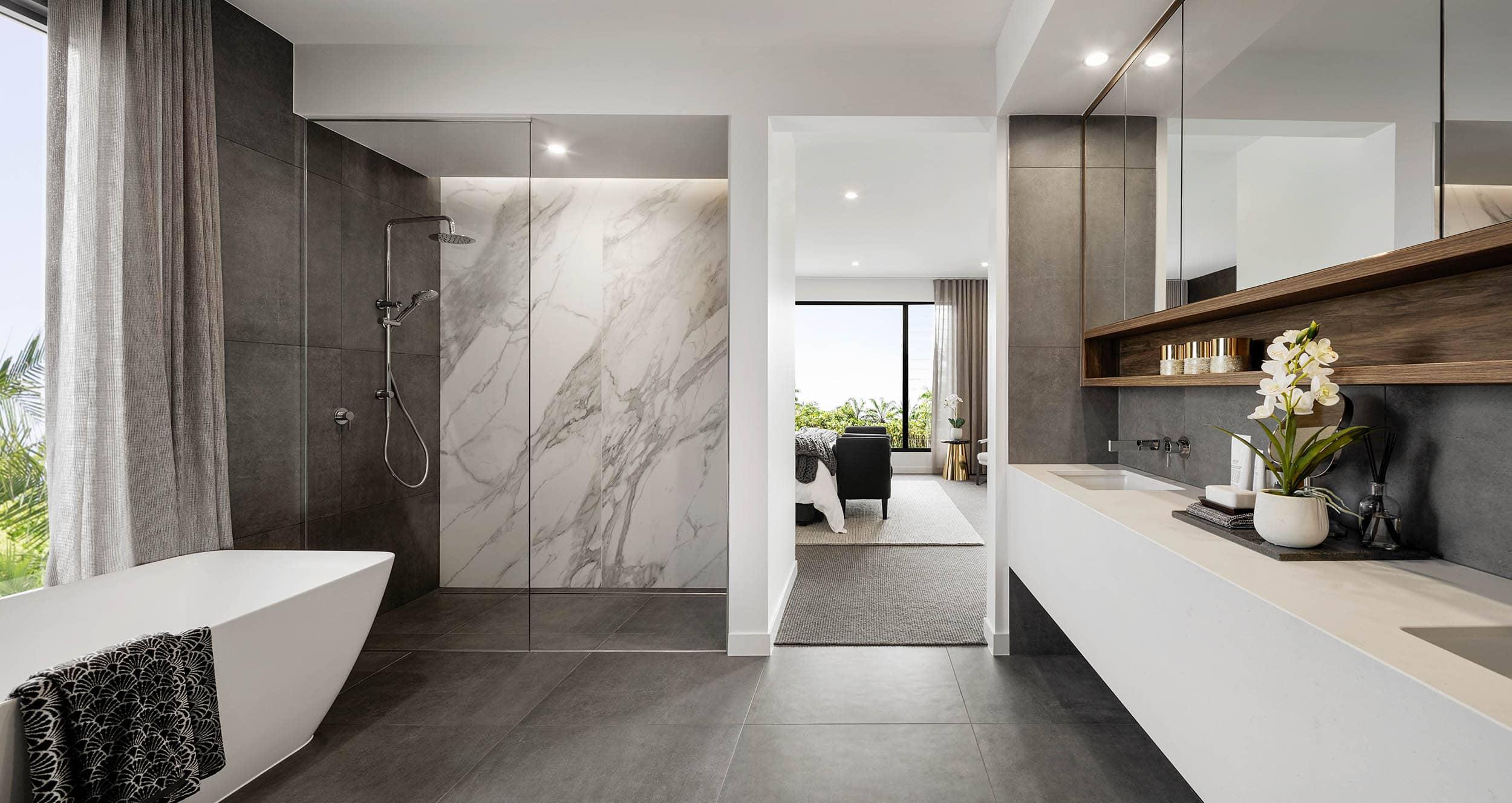 marble vein feature wall in dark moody bathroom with grey floor tiles