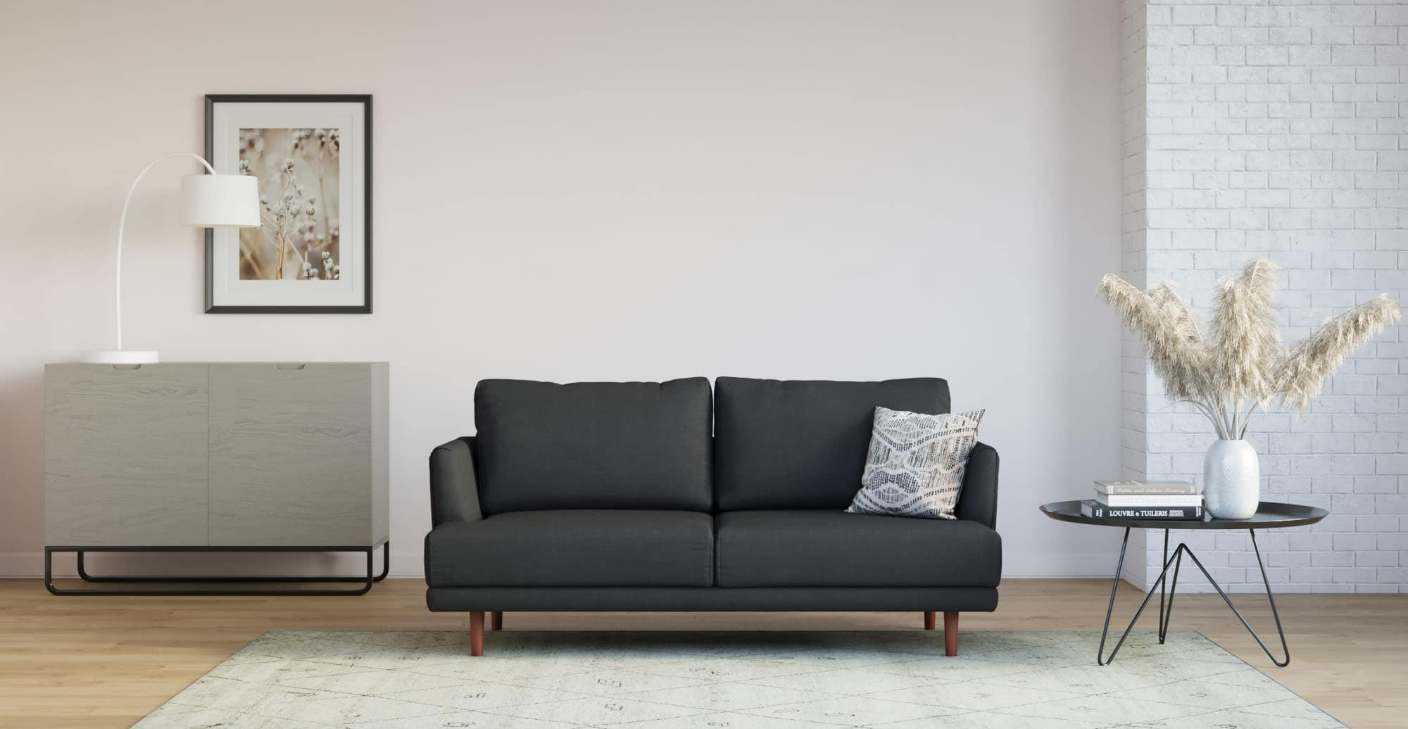 minimalist living room with black sofa and round black metal coffee table on thin legs