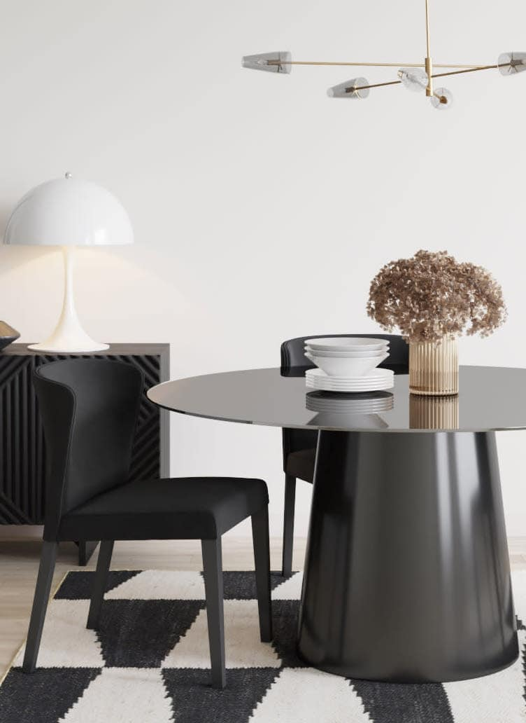 minimalist living room with round black dining table with centre leg and luxe black sideboard