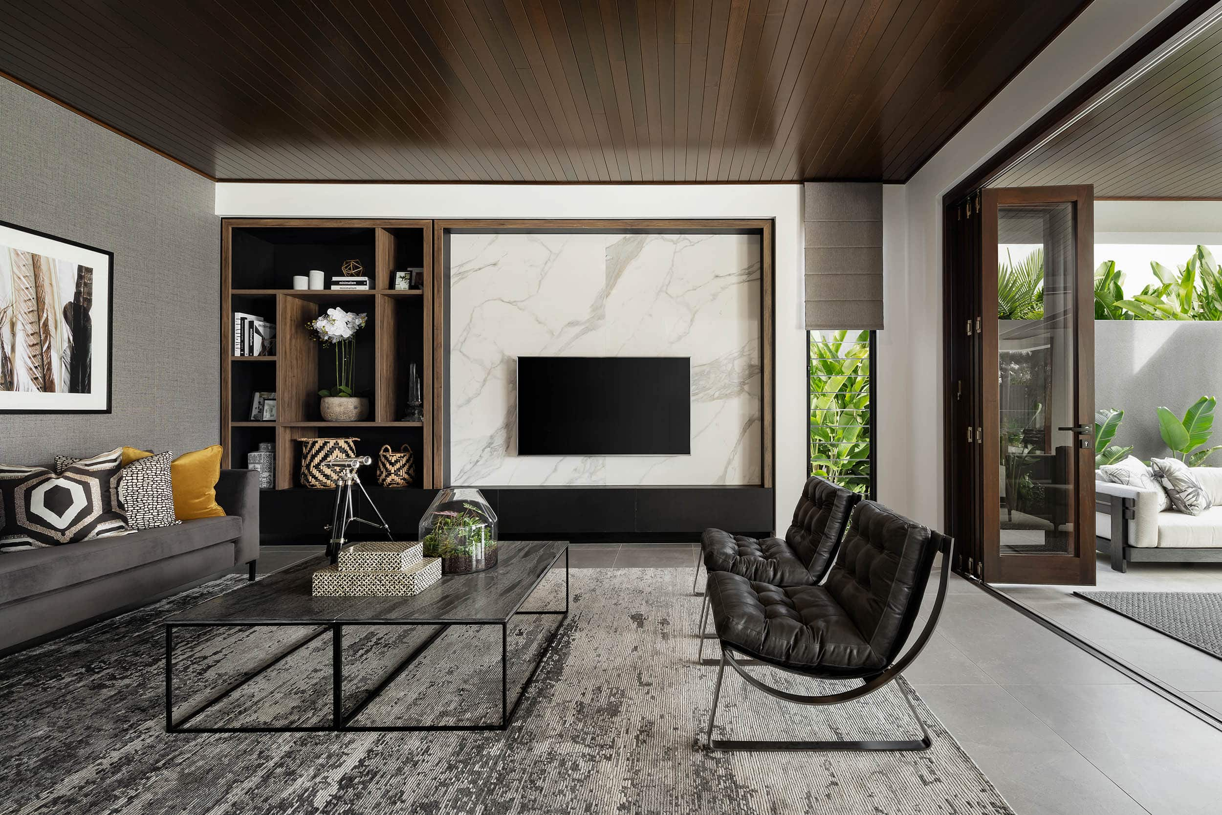 modern dark neutral living room with marble feature wall with timber accents and luxe furniture
