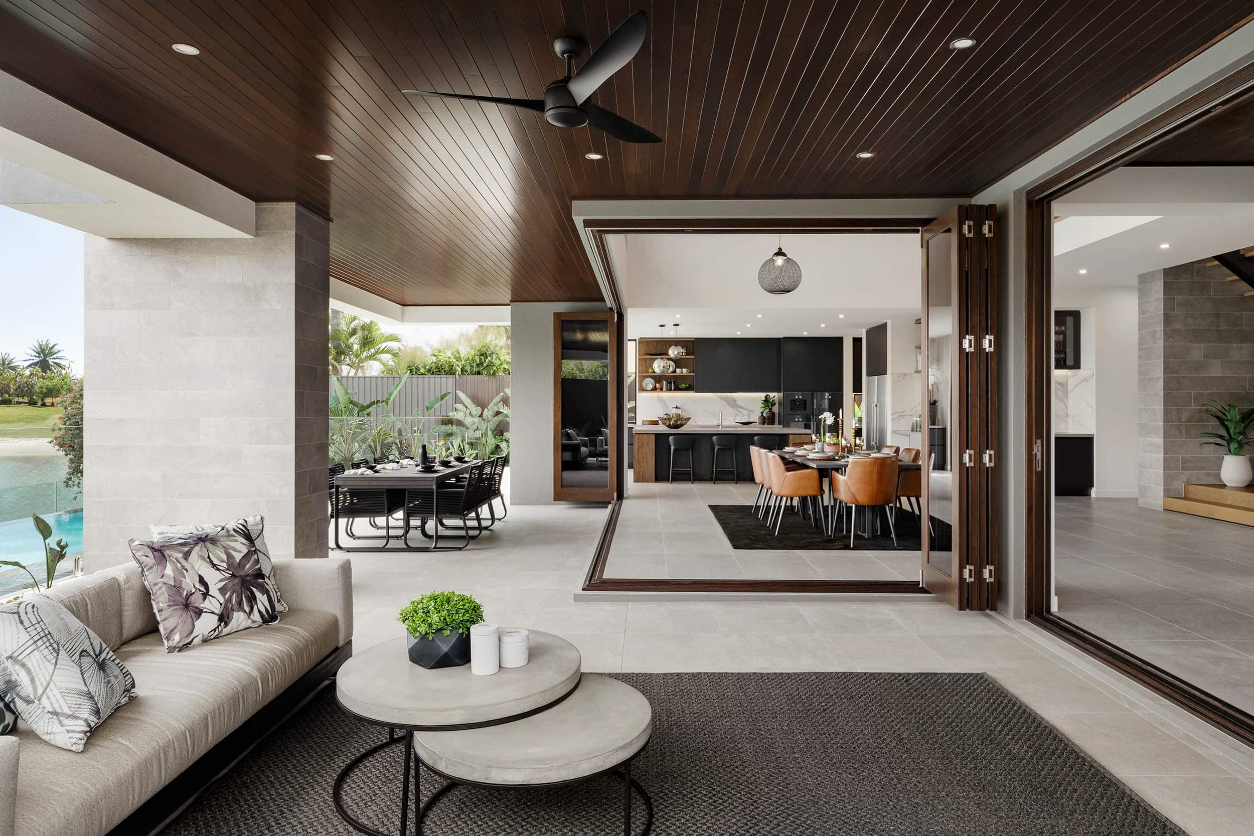 modern home with bi fold doors leading out to alfresco area metricon riviera show home