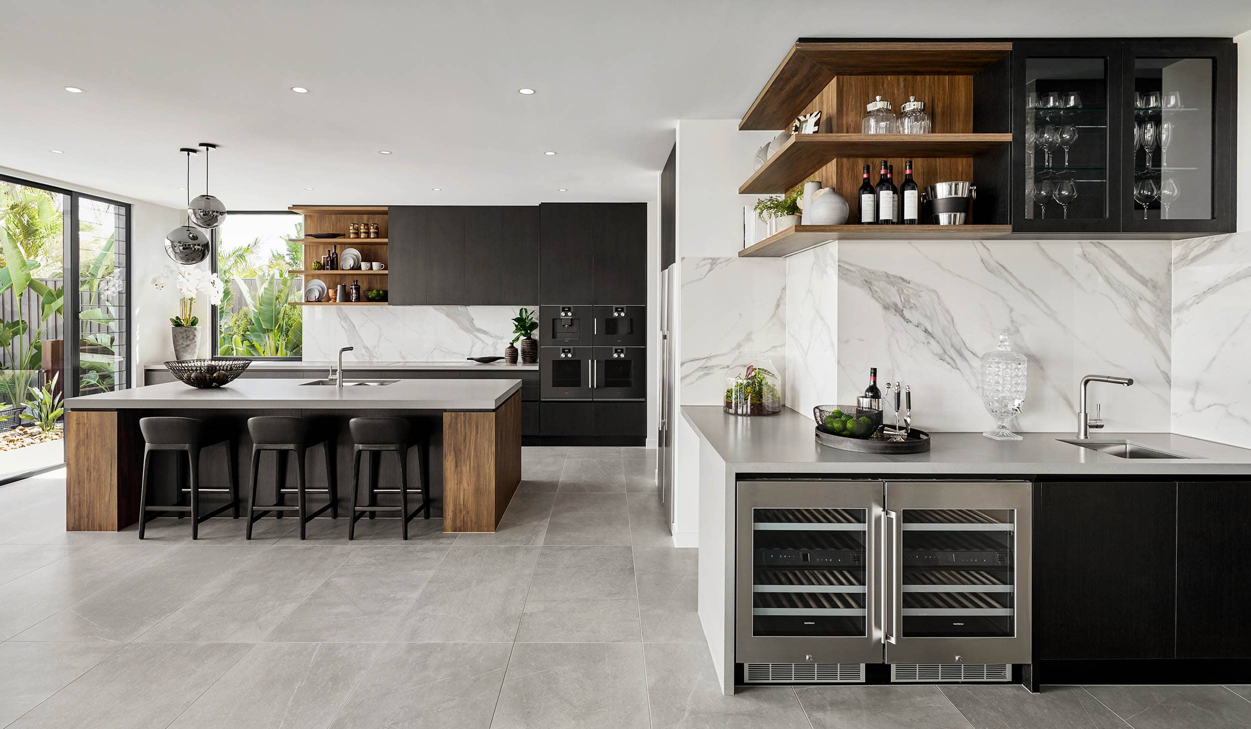modern kitchen with black cabinets marble splashback and timber shelving