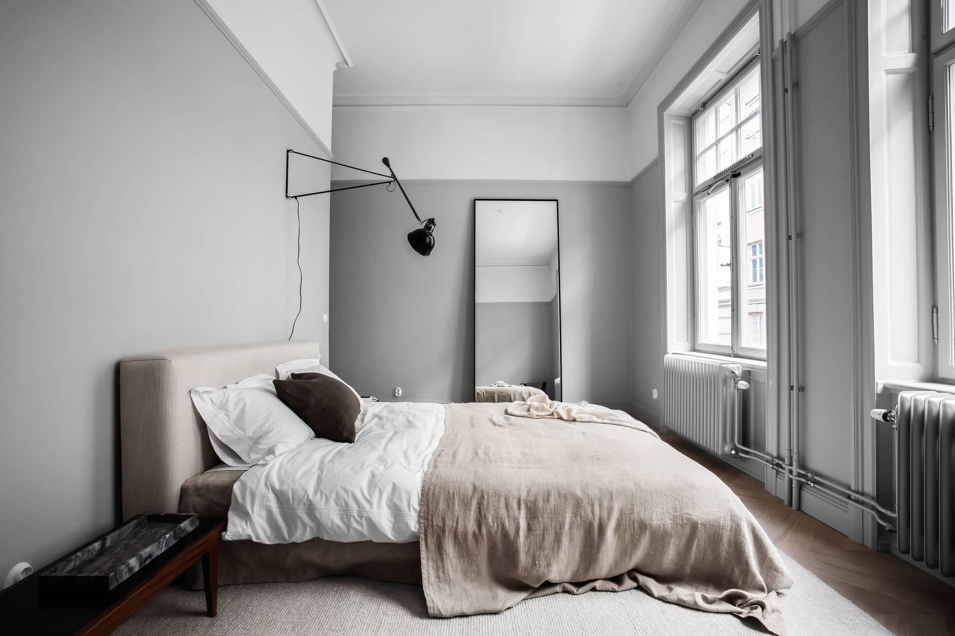 moody neutral bedroom with grey walls dark floors guys bedroom design