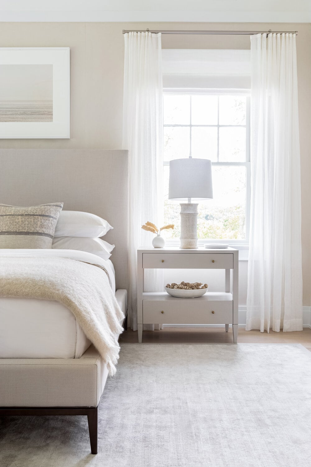 neutral bedroom design with beige bed frame white curtains