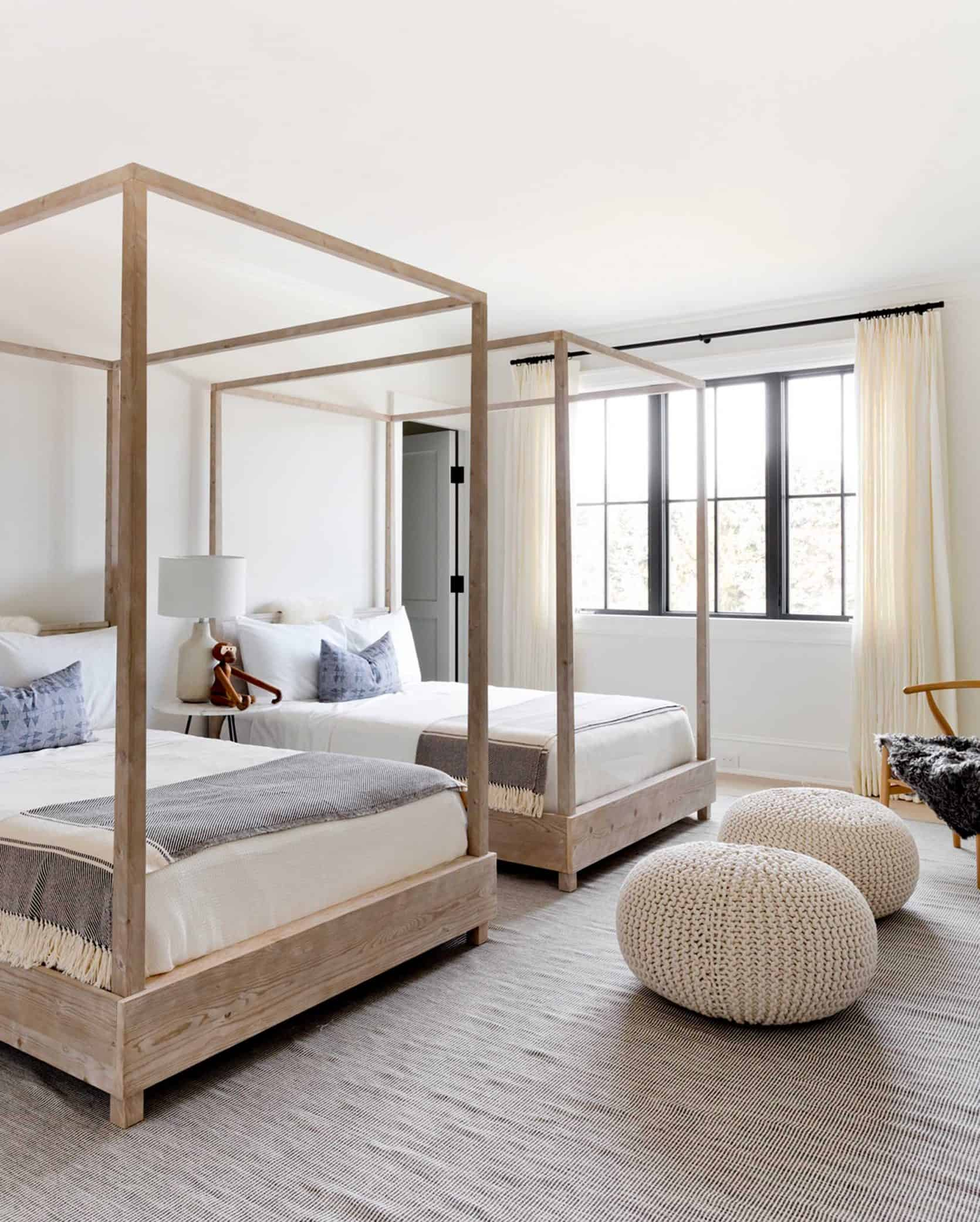 neutral kids bedroom with four poster bed in light timber emily henderson