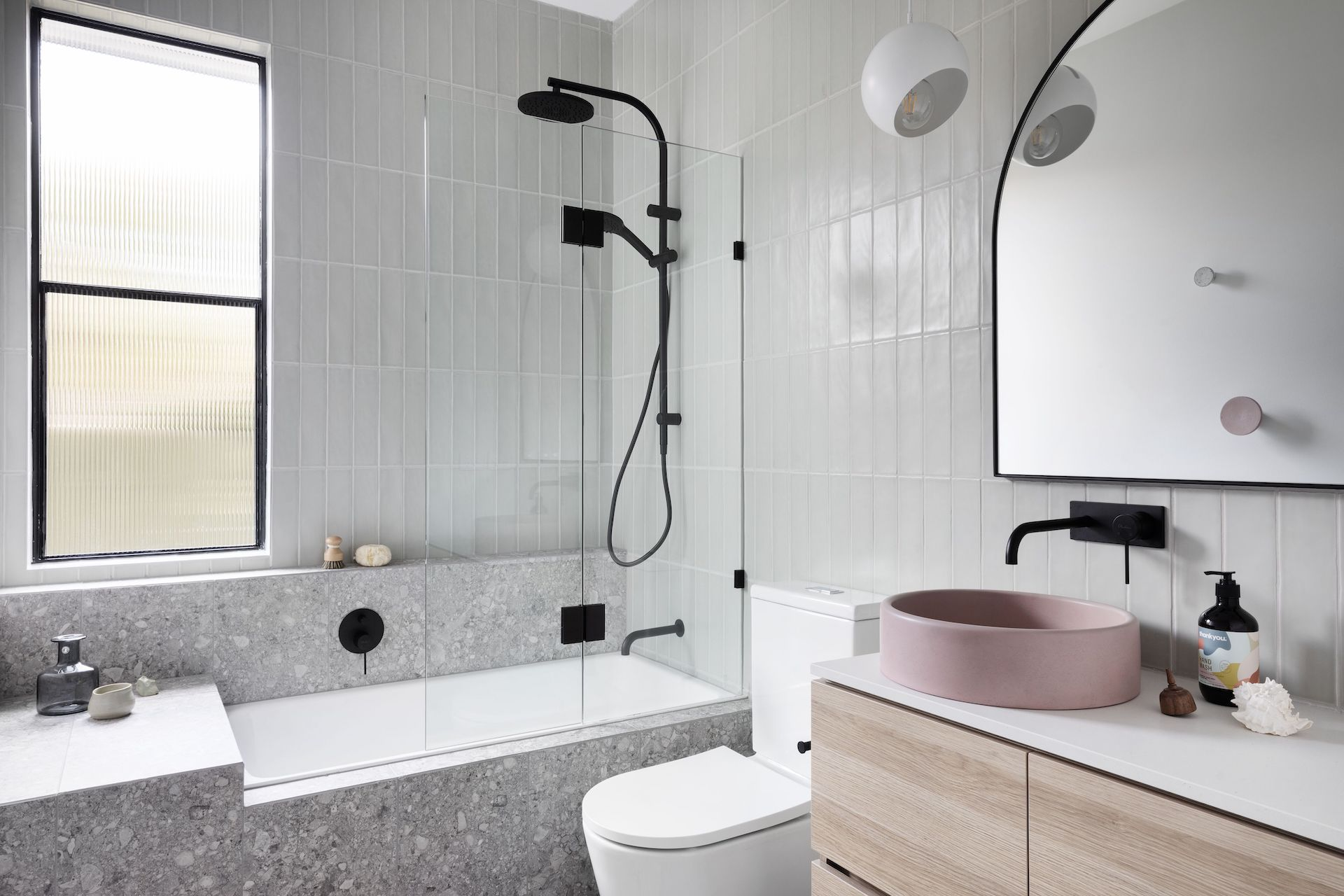 nood co round coloured bathroom basin in chic grey bathroom with black taps
